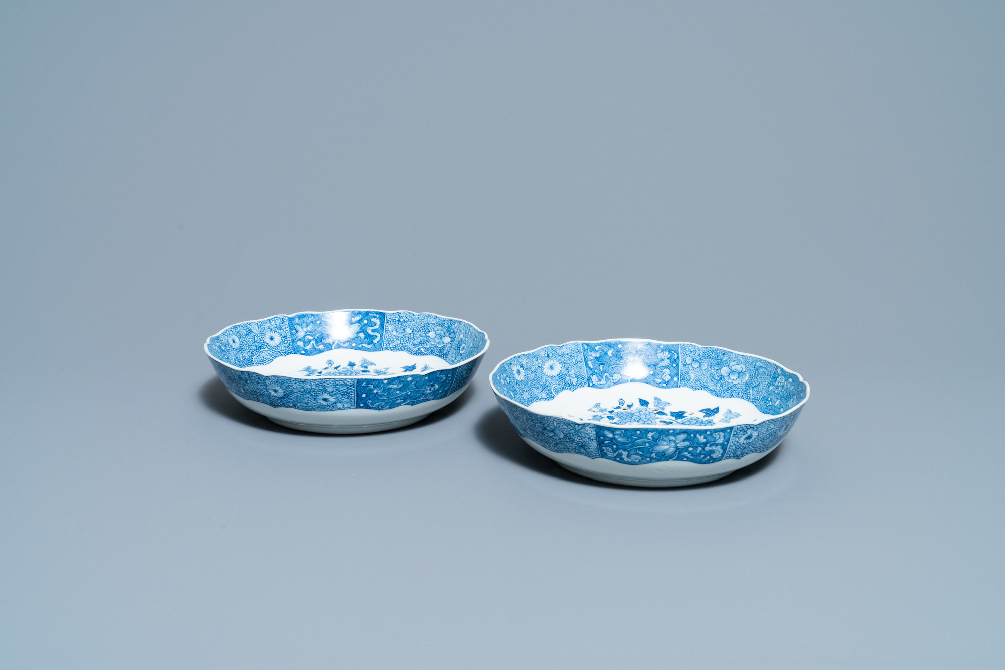 A pair of Chinese blue and white strainer dishes with ladies in a garden, Qianlong - Image 4 of 4