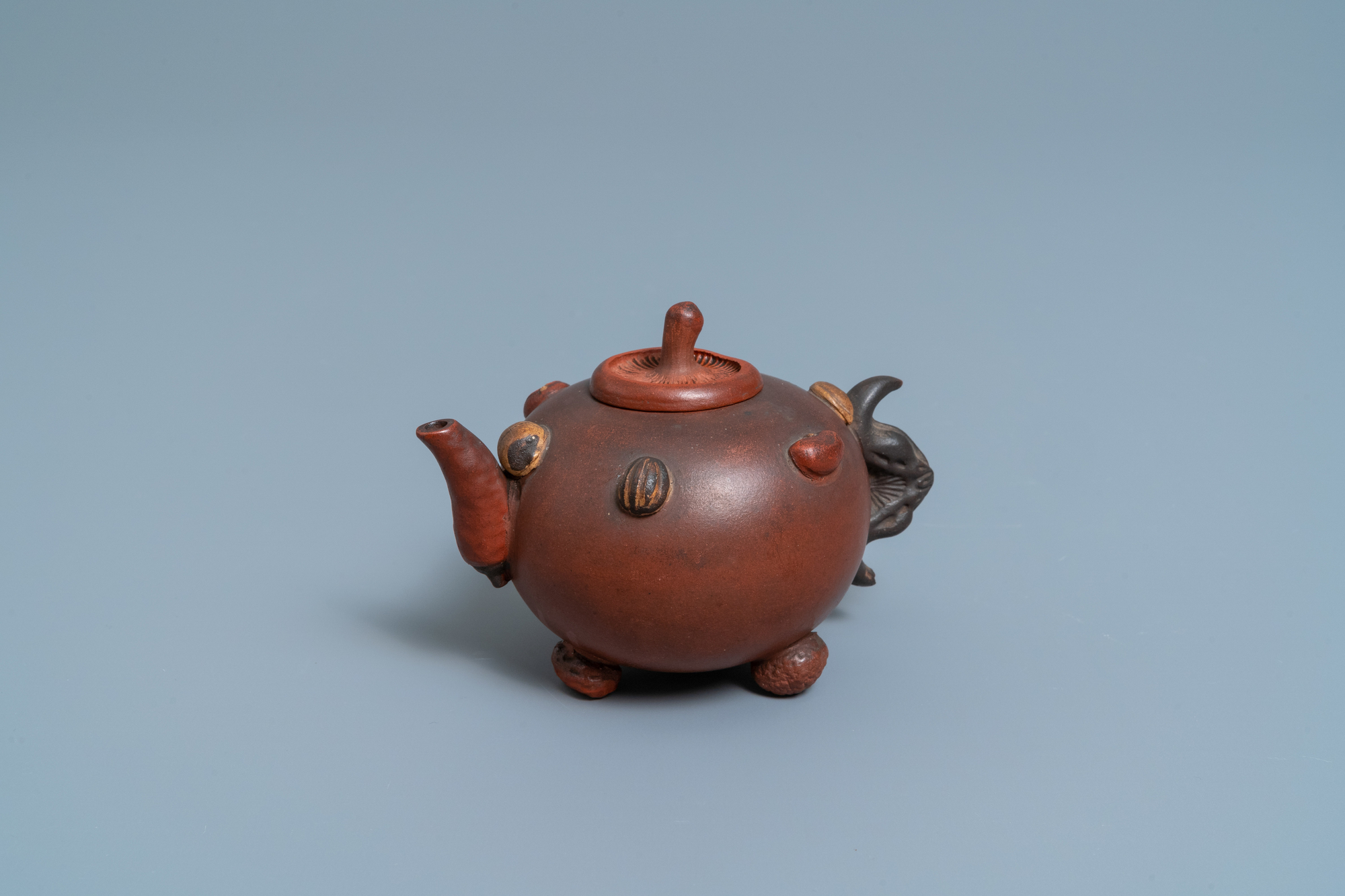 A Chinese Yixing stoneware teapot and cover with applied nuts, 19/20th C.