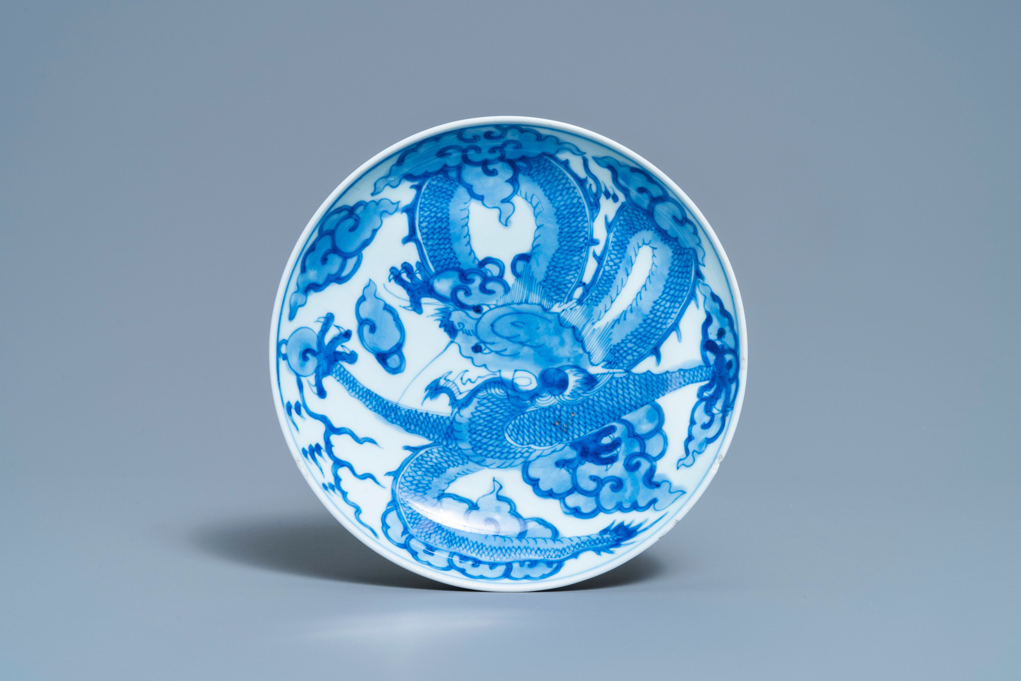 A Chinese blue and white 'dragon' dish, Yongzheng mark and of the period