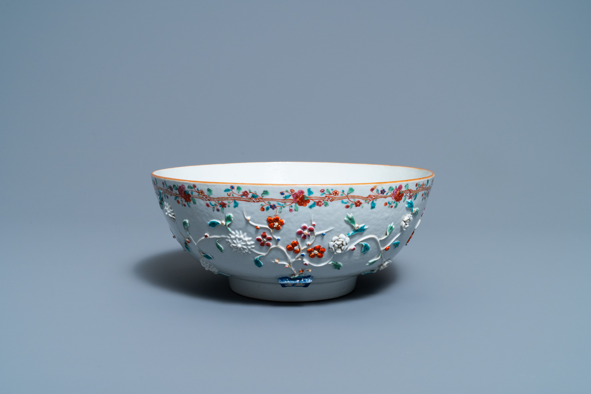 A Chinese famille rose relief-decorated floral bowl, Yongzheng/Qianlong
