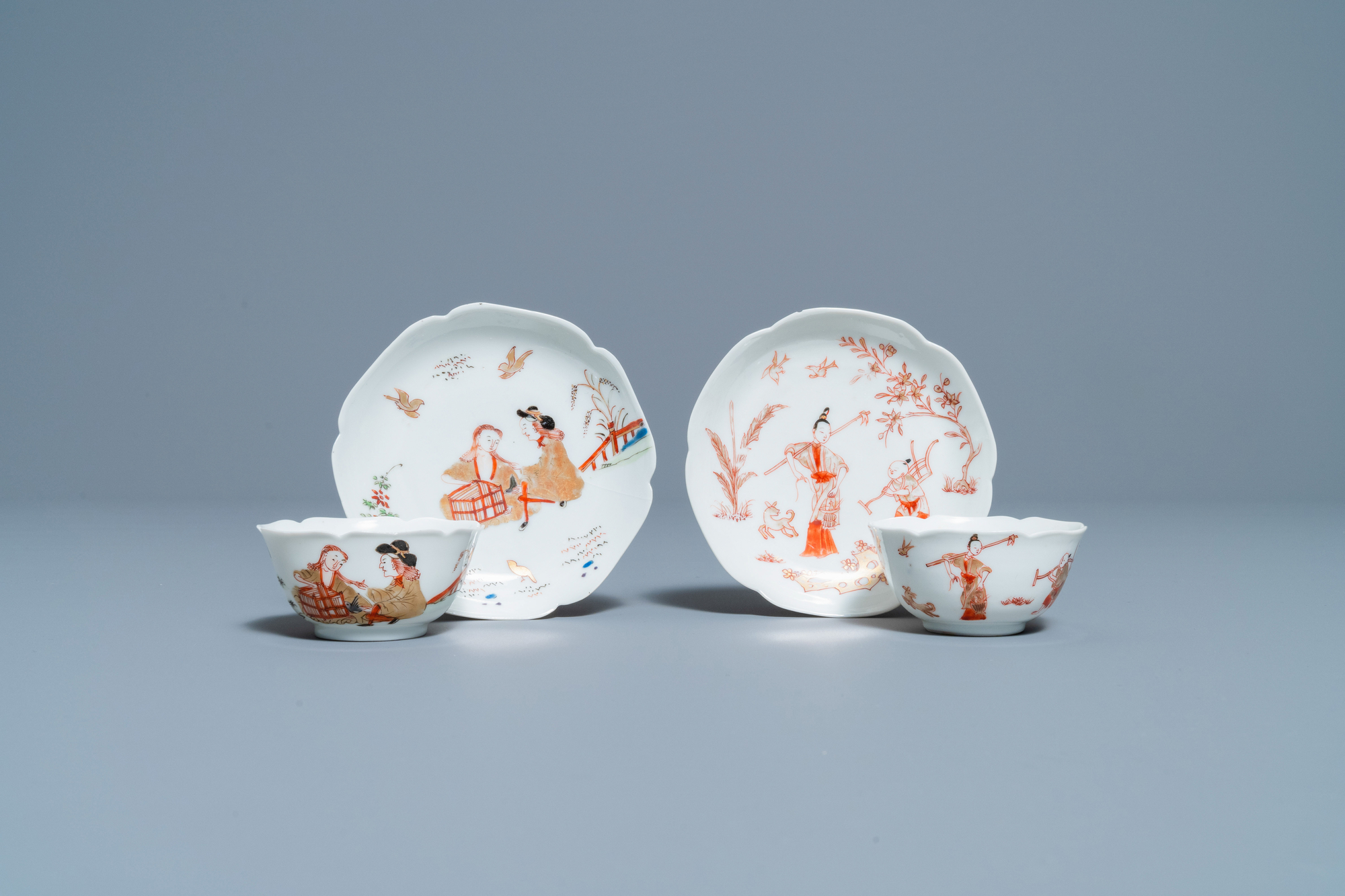 Two Chinese iron-red and gilt cups and saucers, Yongzheng