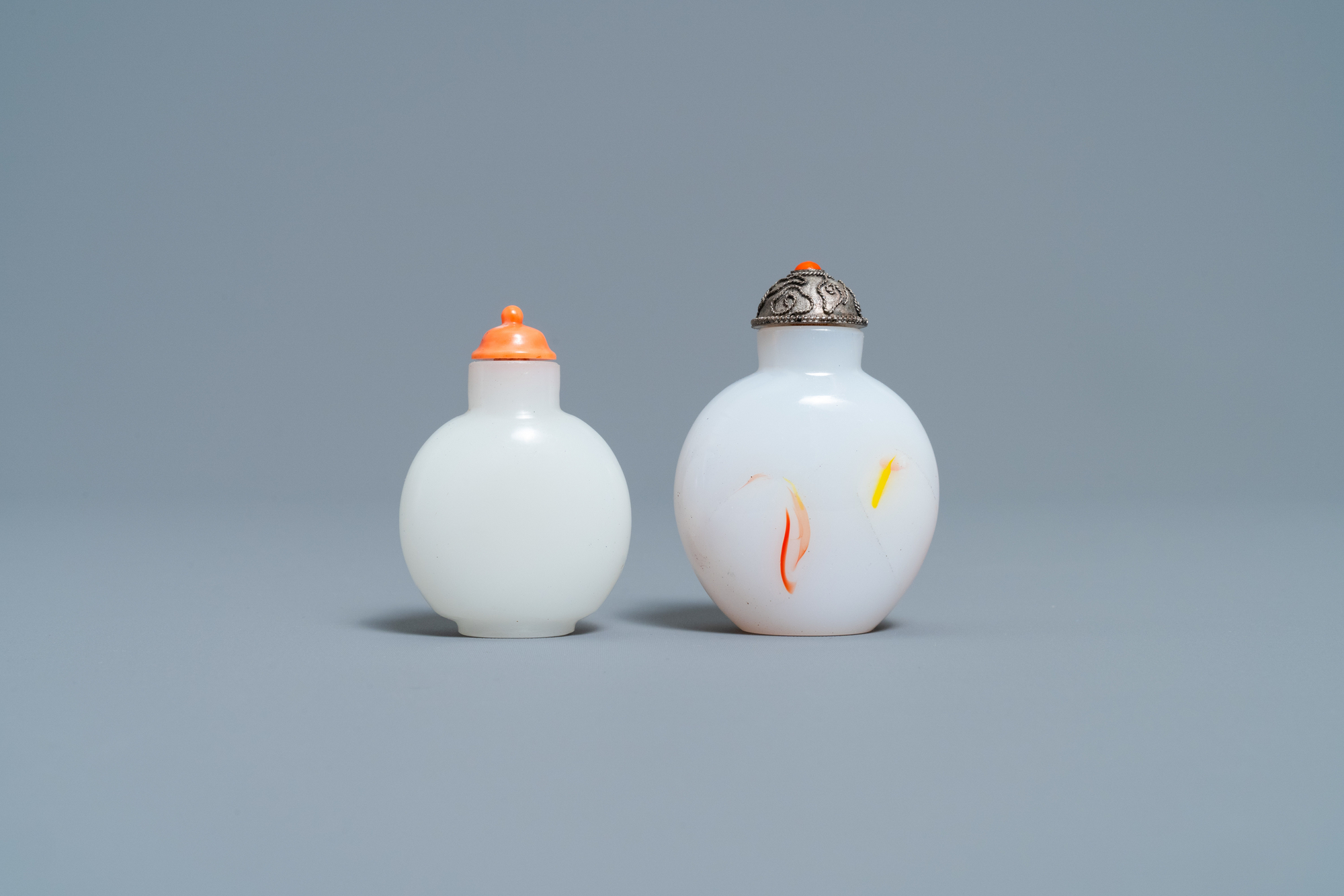 A Chinese white jade coral-topped snuff bottle and one in glass with inclusions, 19th C. - Image 2 of 7