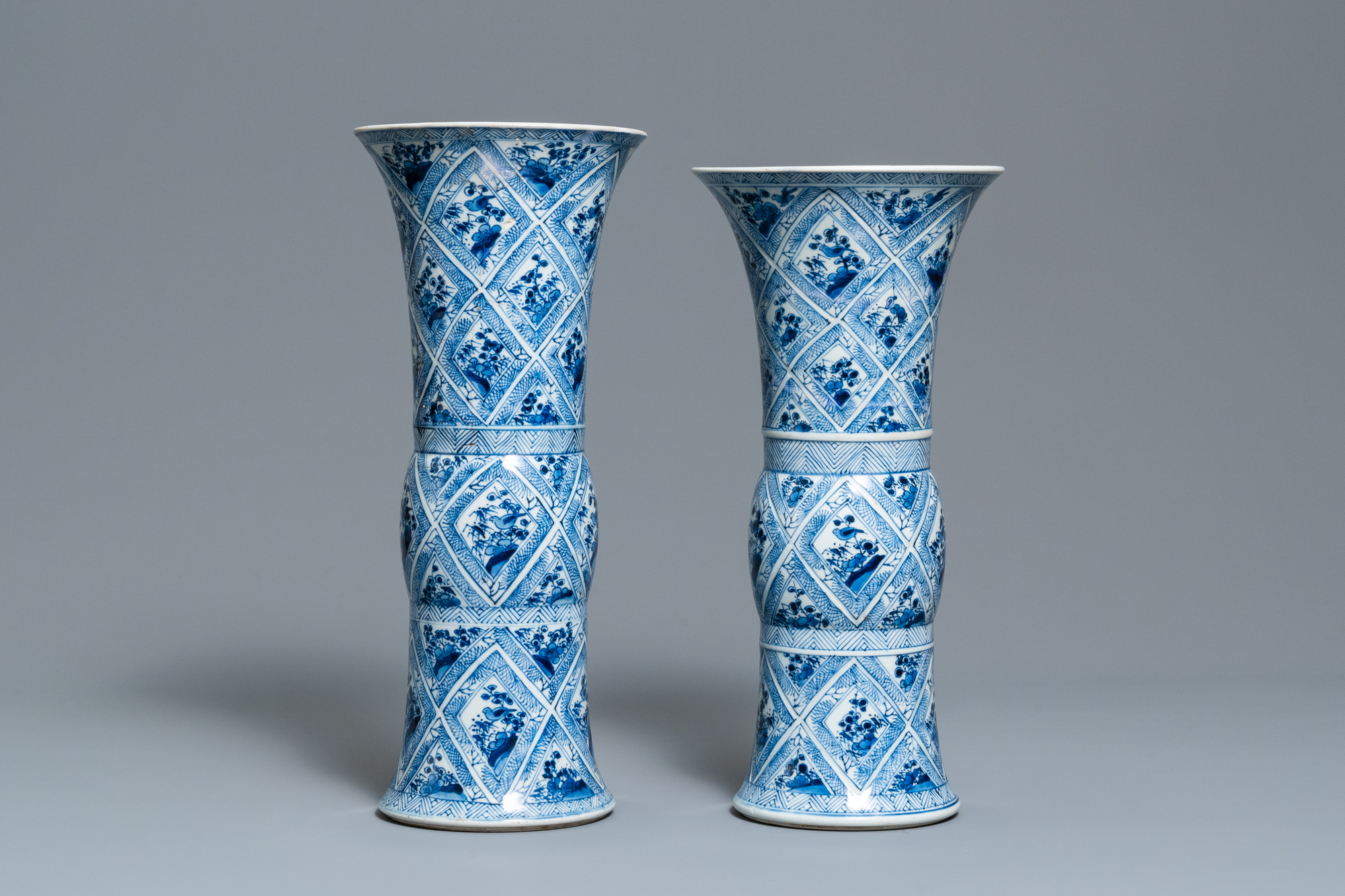 A large Chinese blue and white five-piece garniture with floral and landscape panels, Kangxi - Image 13 of 66