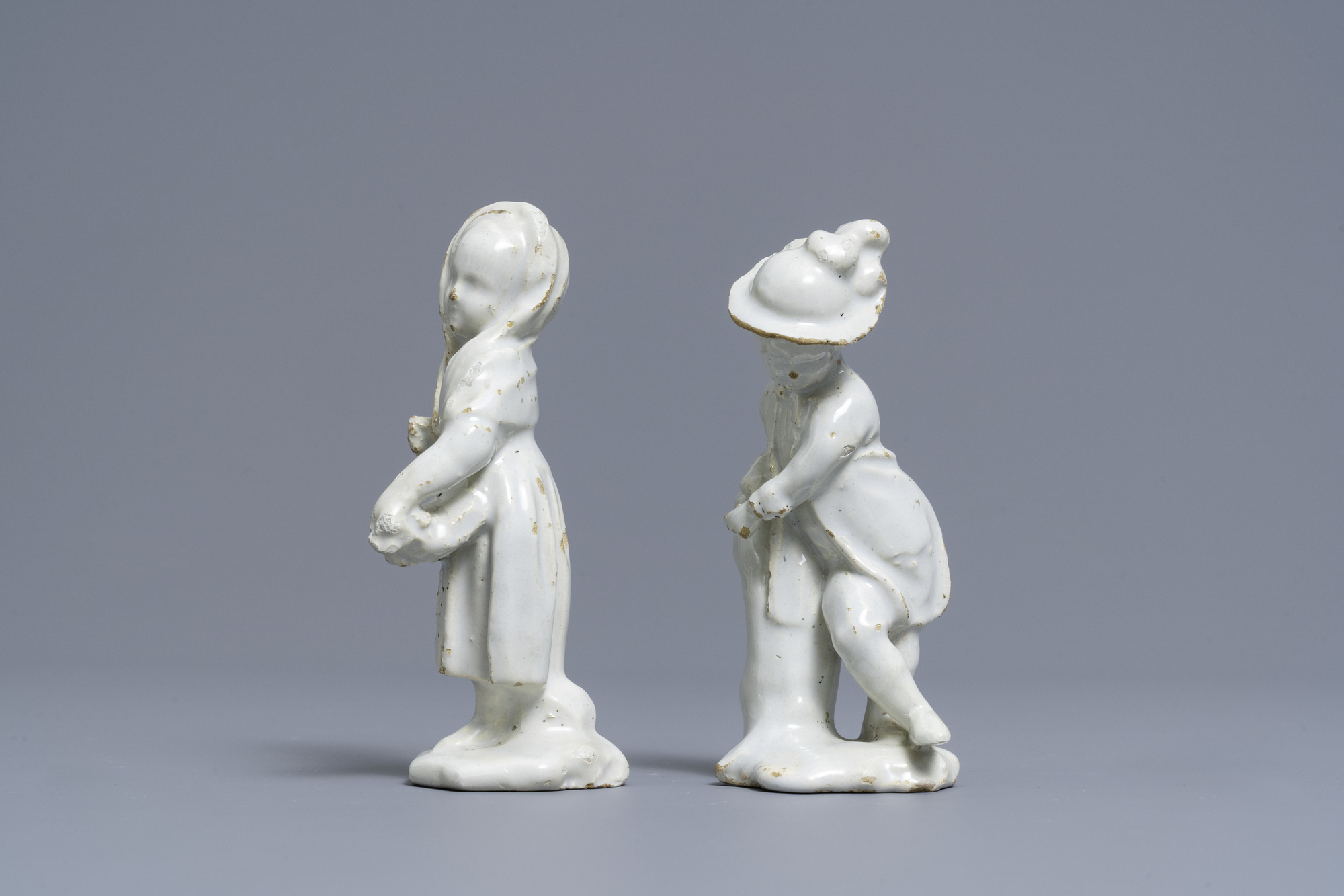 Two white Dutch Delftware figures of a boy and a girl, 18th C. - Image 5 of 7