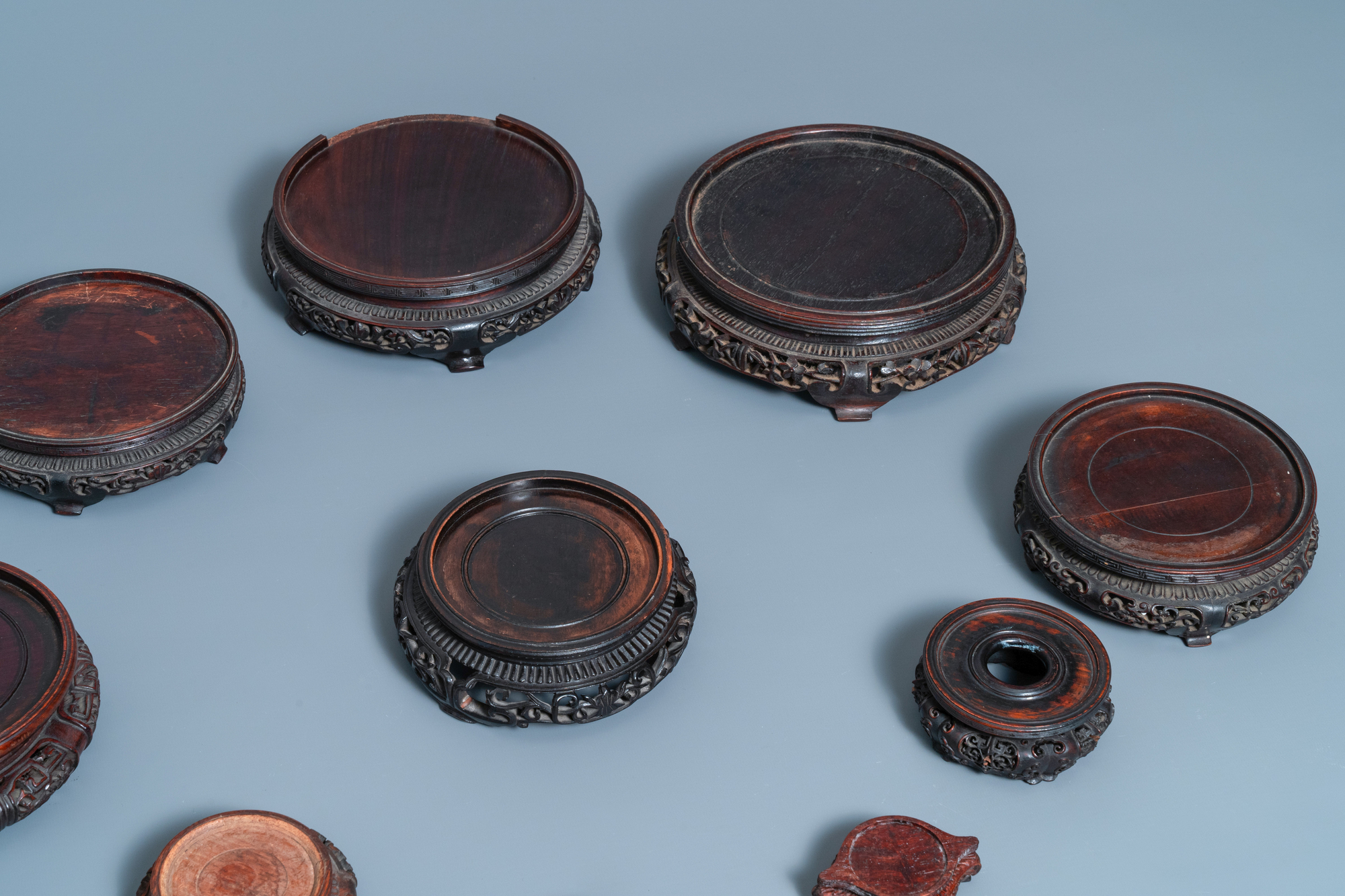 Ten Chinese reticulated carved wooden stands, 19/20th C. - Image 2 of 4