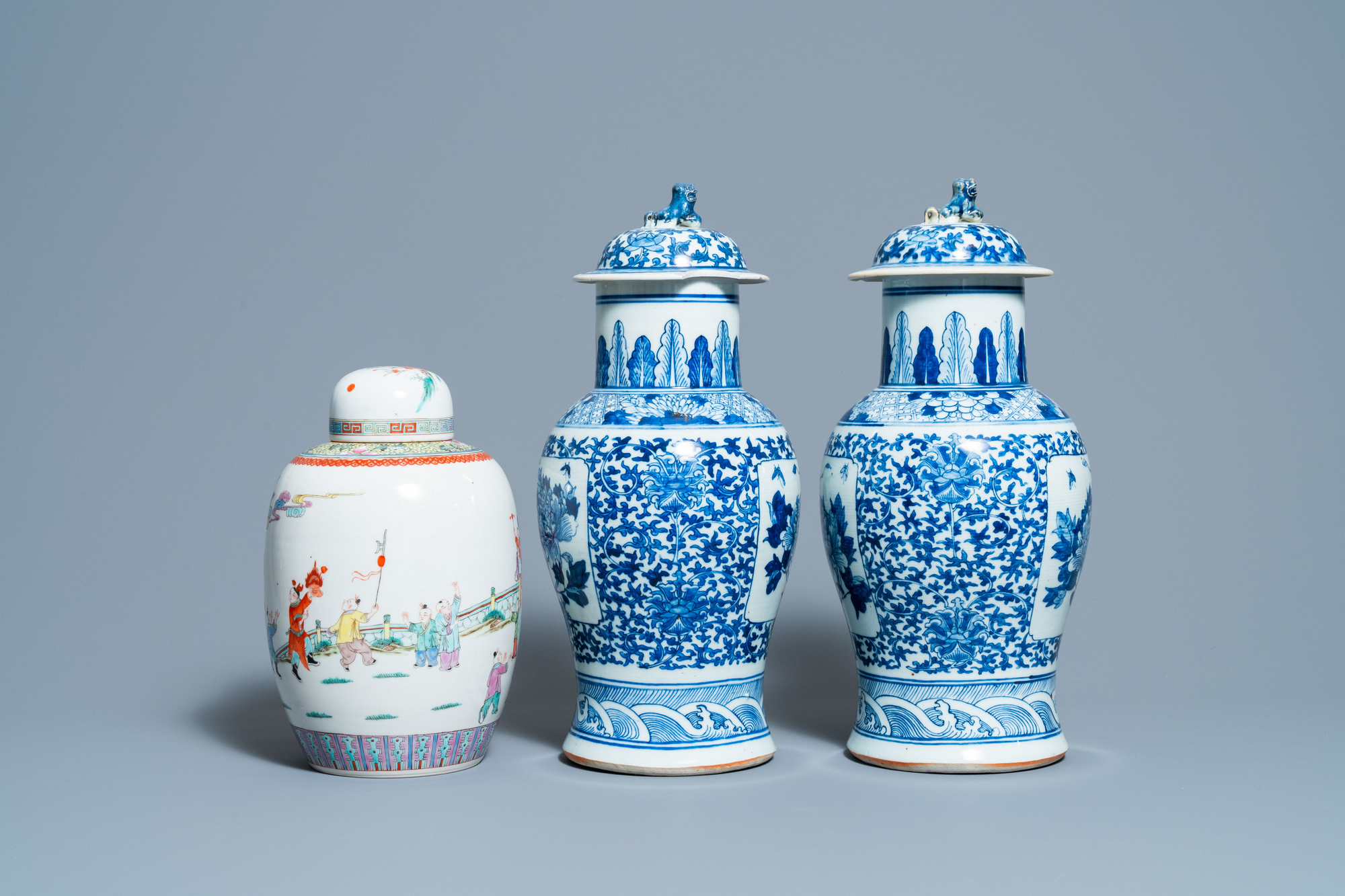 A pair of Chinese blue and white vases and a famille rose jar and cover, 19/20th C. - Image 5 of 9