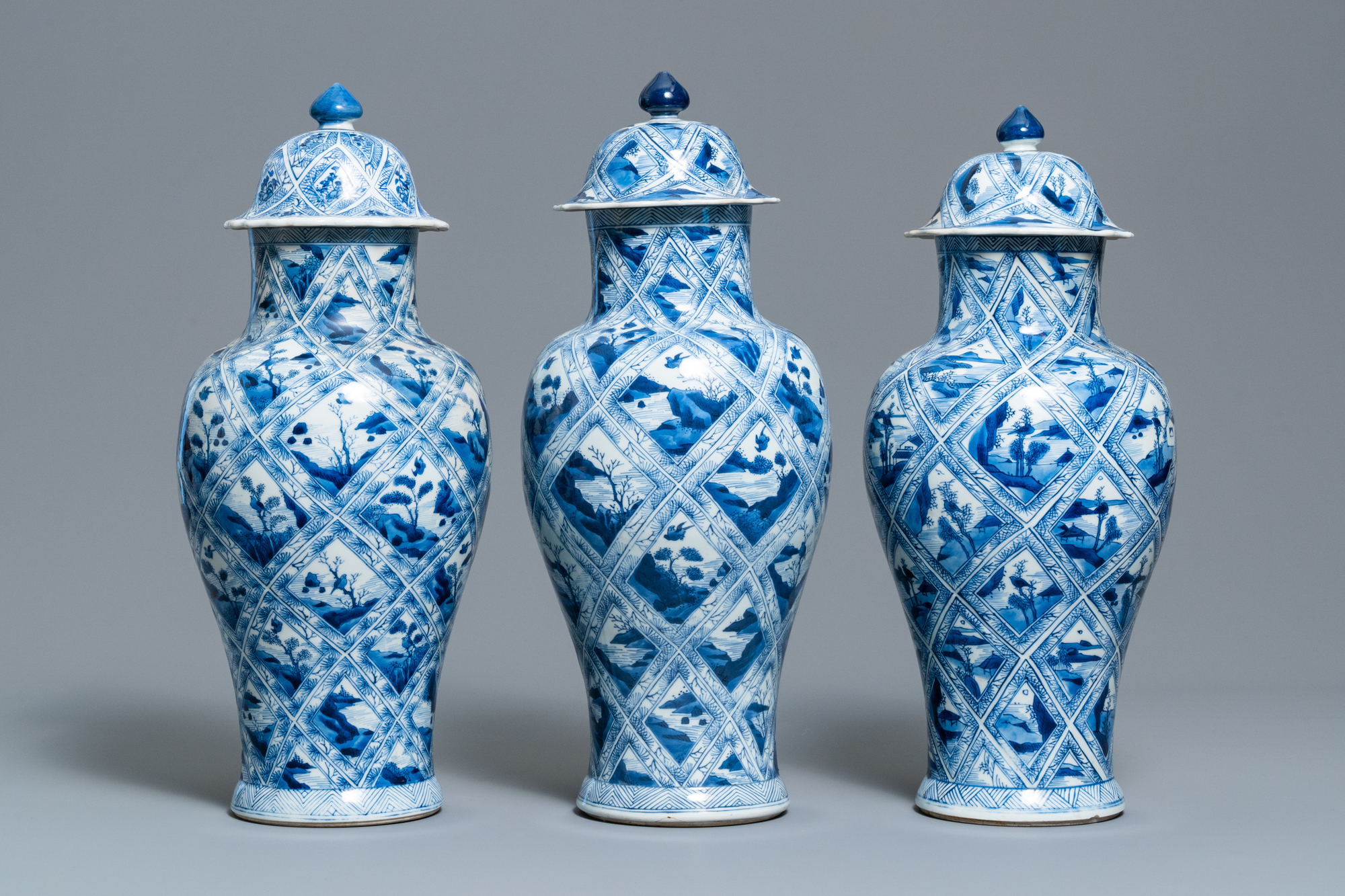 A large Chinese blue and white five-piece garniture with floral and landscape panels, Kangxi - Image 2 of 66