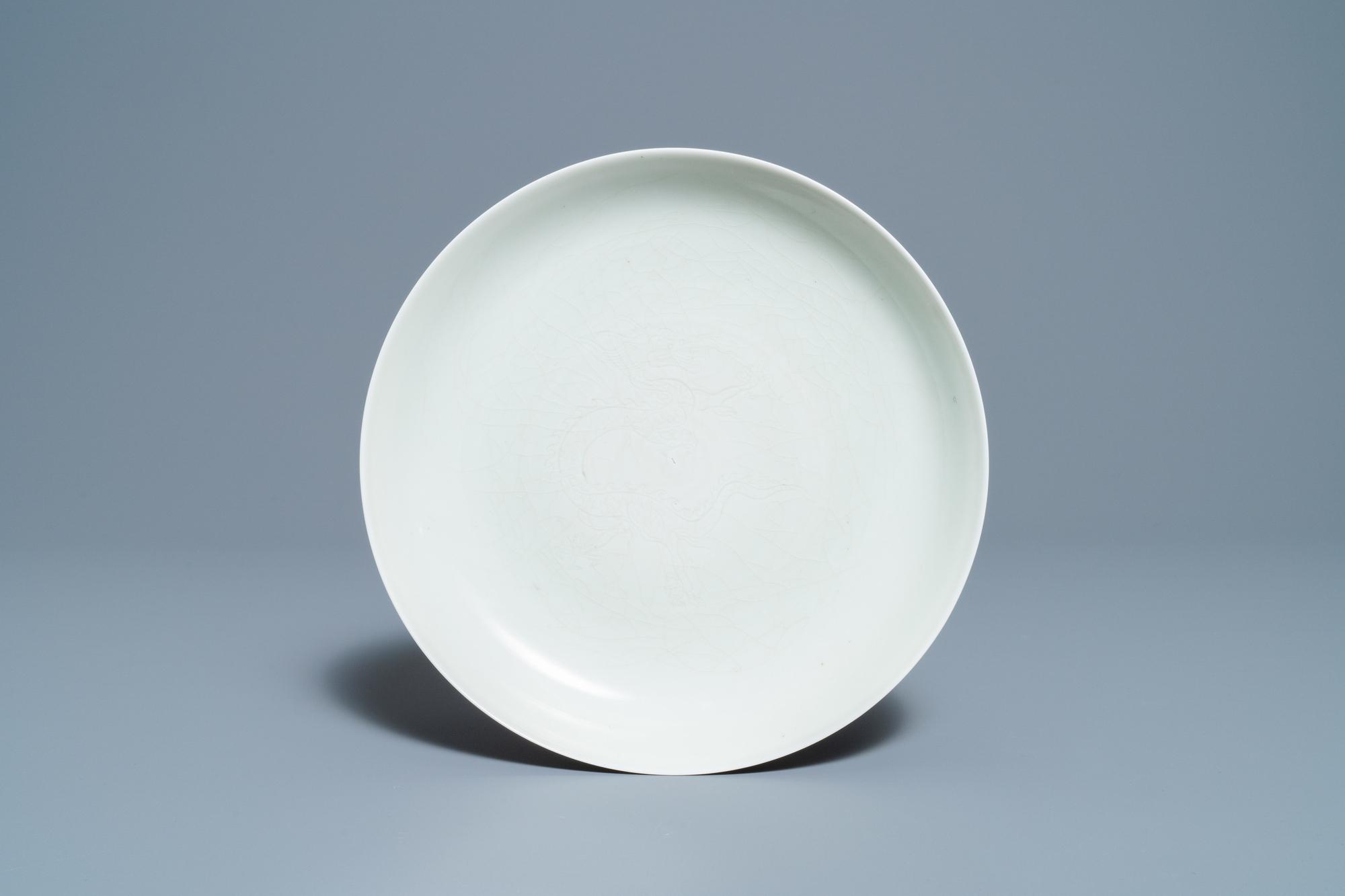 A Chinese monochrome celadon underglaze 'dragon' dish, Qianlong/Jiaqing