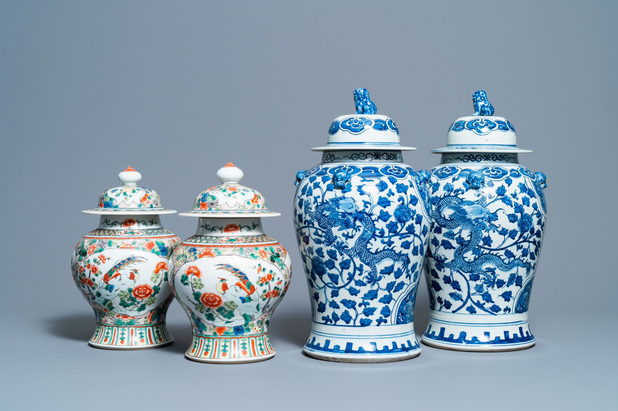 Two pairs of Chinese blue and white and famille verte vases and covers, 19/20th C.