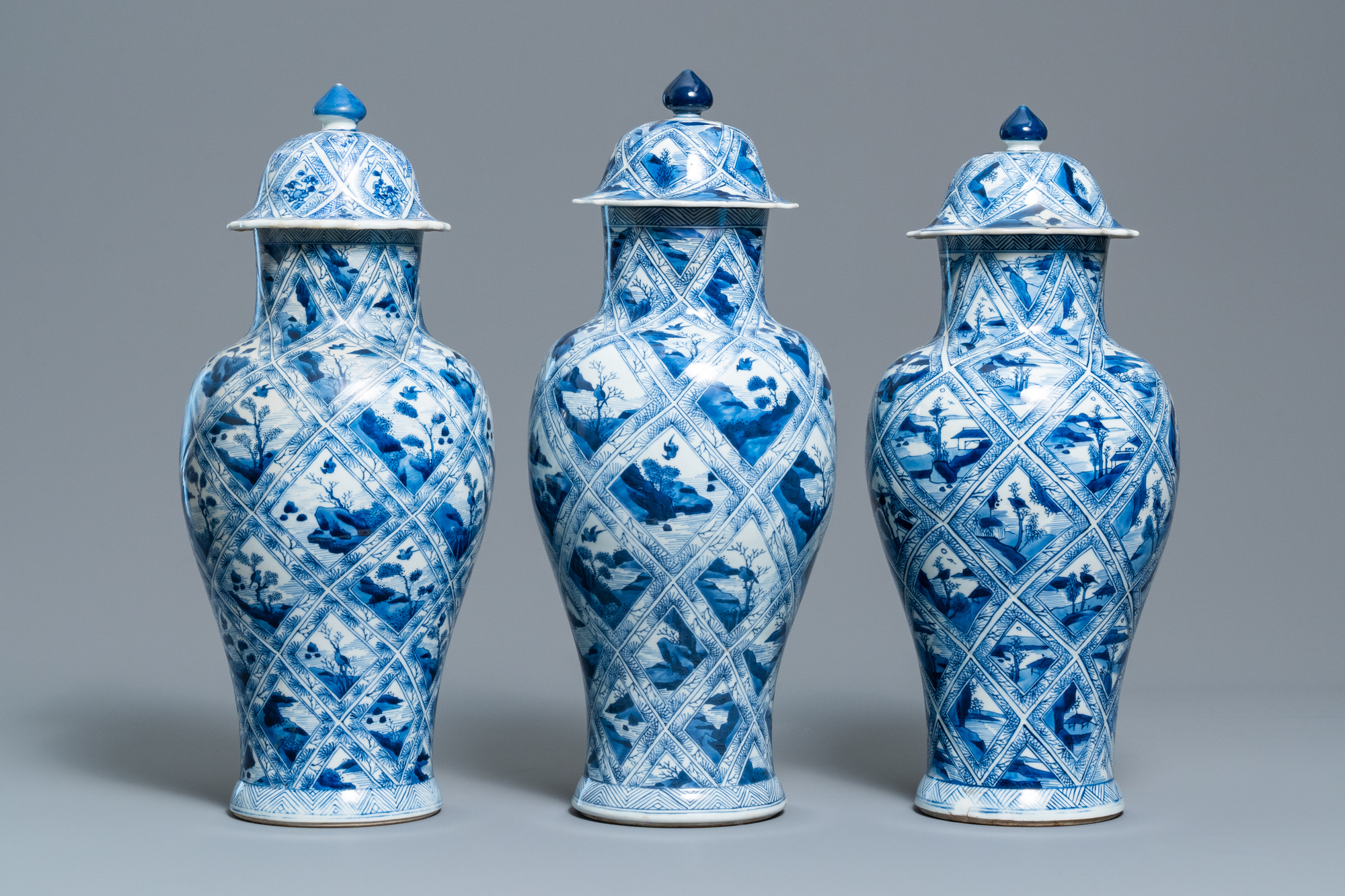 A large Chinese blue and white five-piece garniture with floral and landscape panels, Kangxi - Image 5 of 66