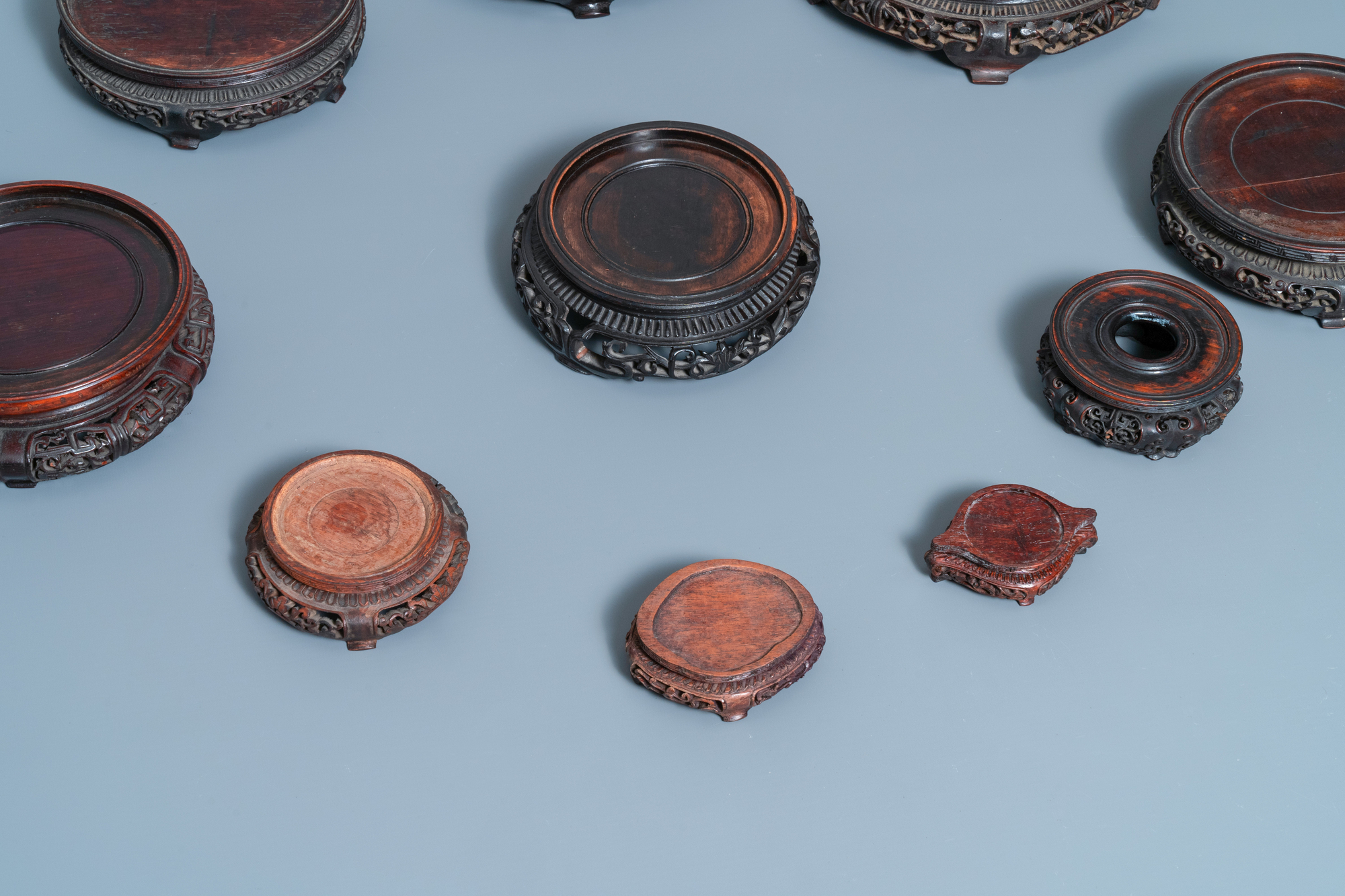 Ten Chinese reticulated carved wooden stands, 19/20th C. - Image 3 of 4