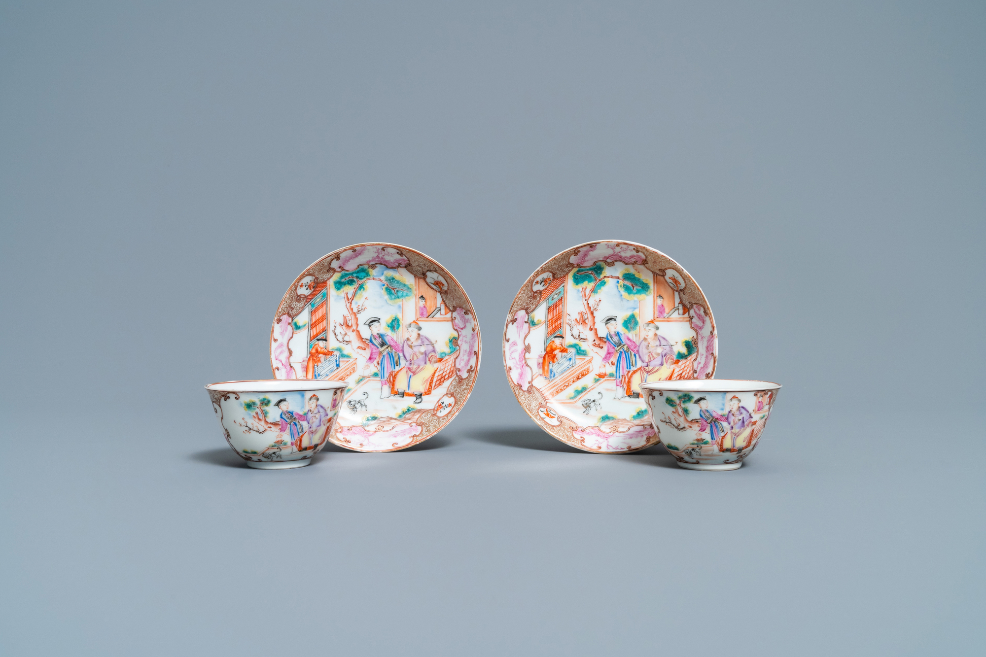 A pair of fine Chinese famille rose 'Mandarin' cups and saucers, Qianlong