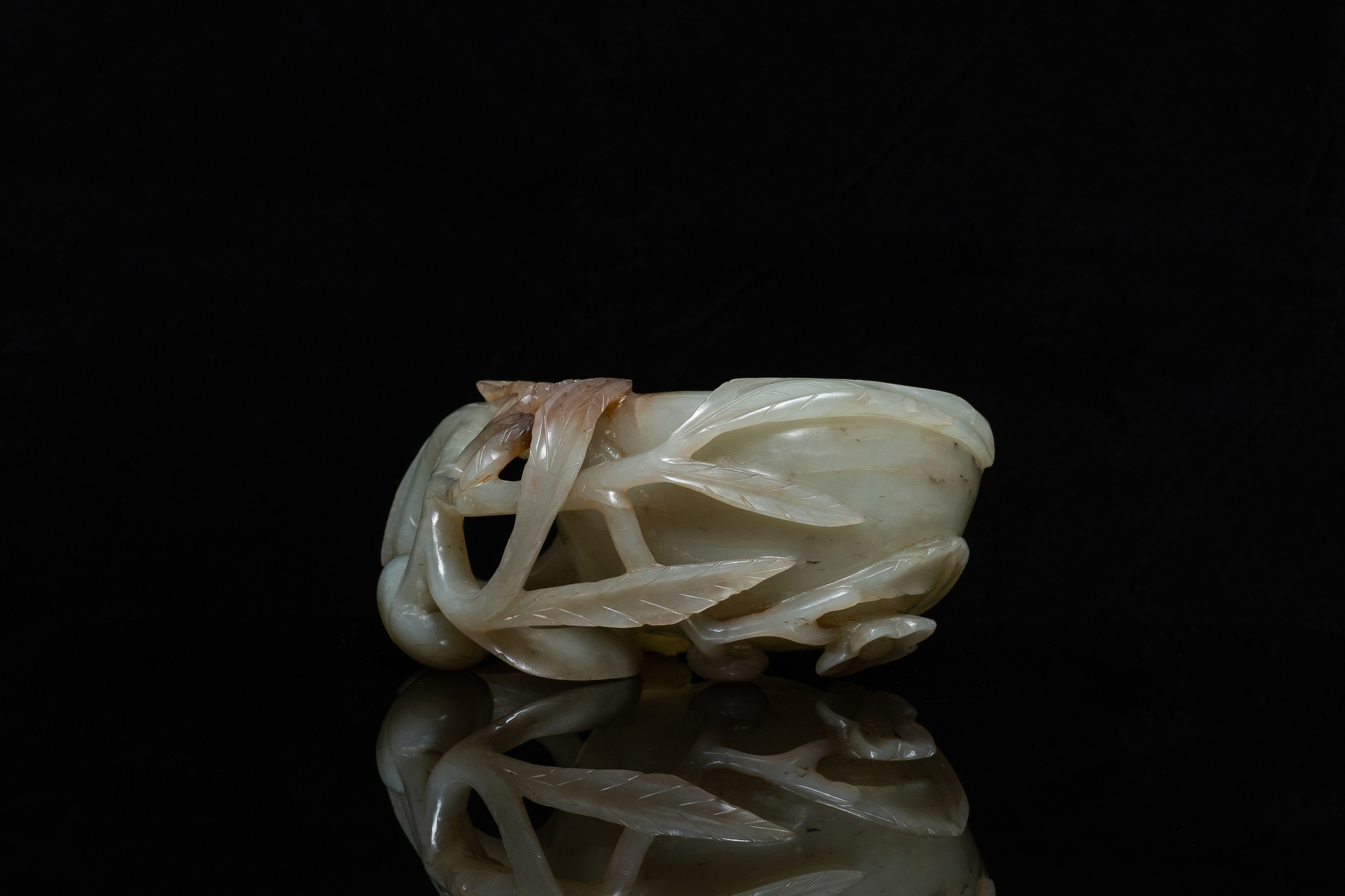 A Chinese mottled celadon and brown jade peach-form brush washer, Qing - Image 4 of 12