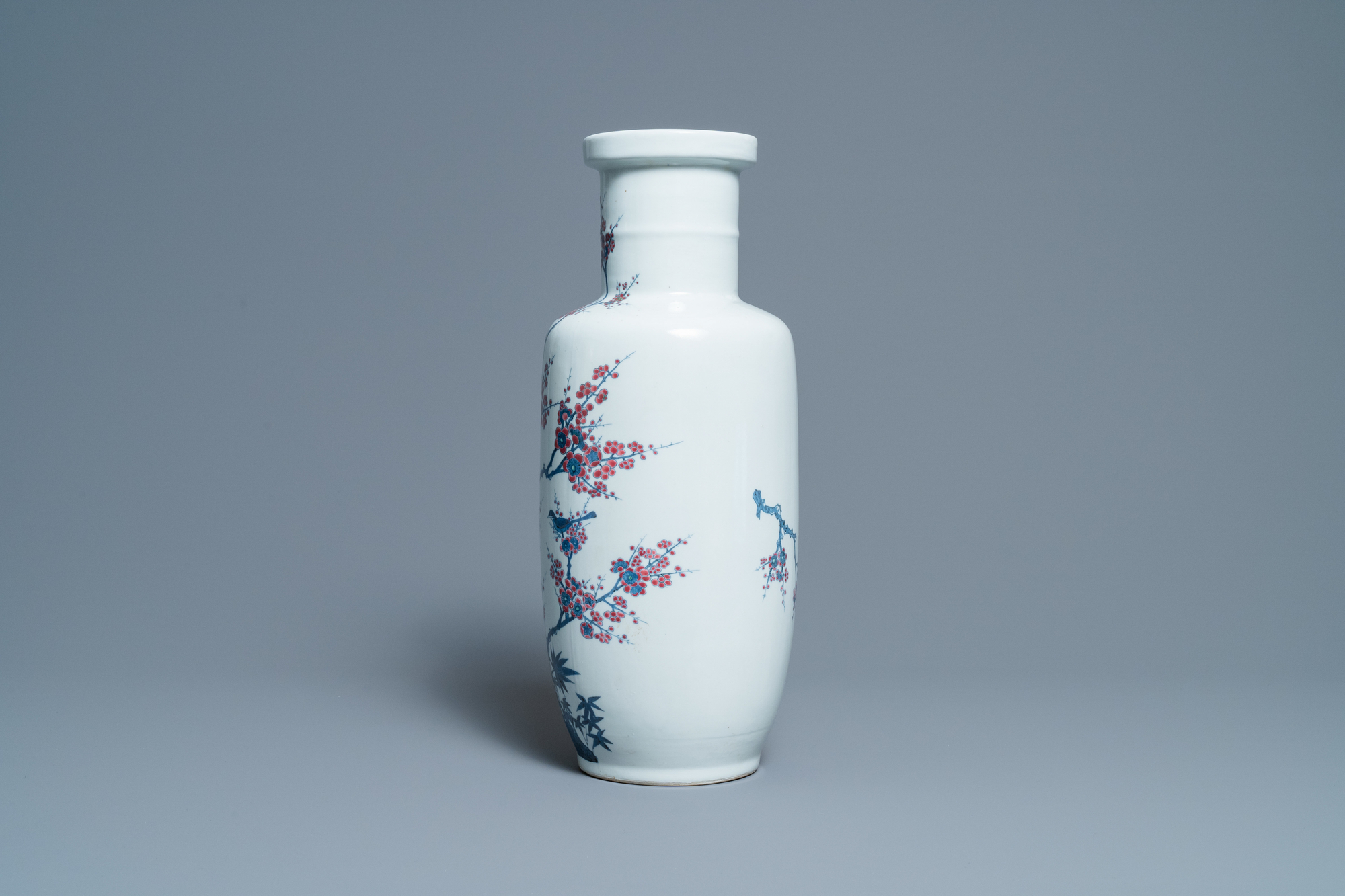 A Chinese blue, white and copper-red rouleau vase with birds among blossoming branches, 20th C. - Image 2 of 6