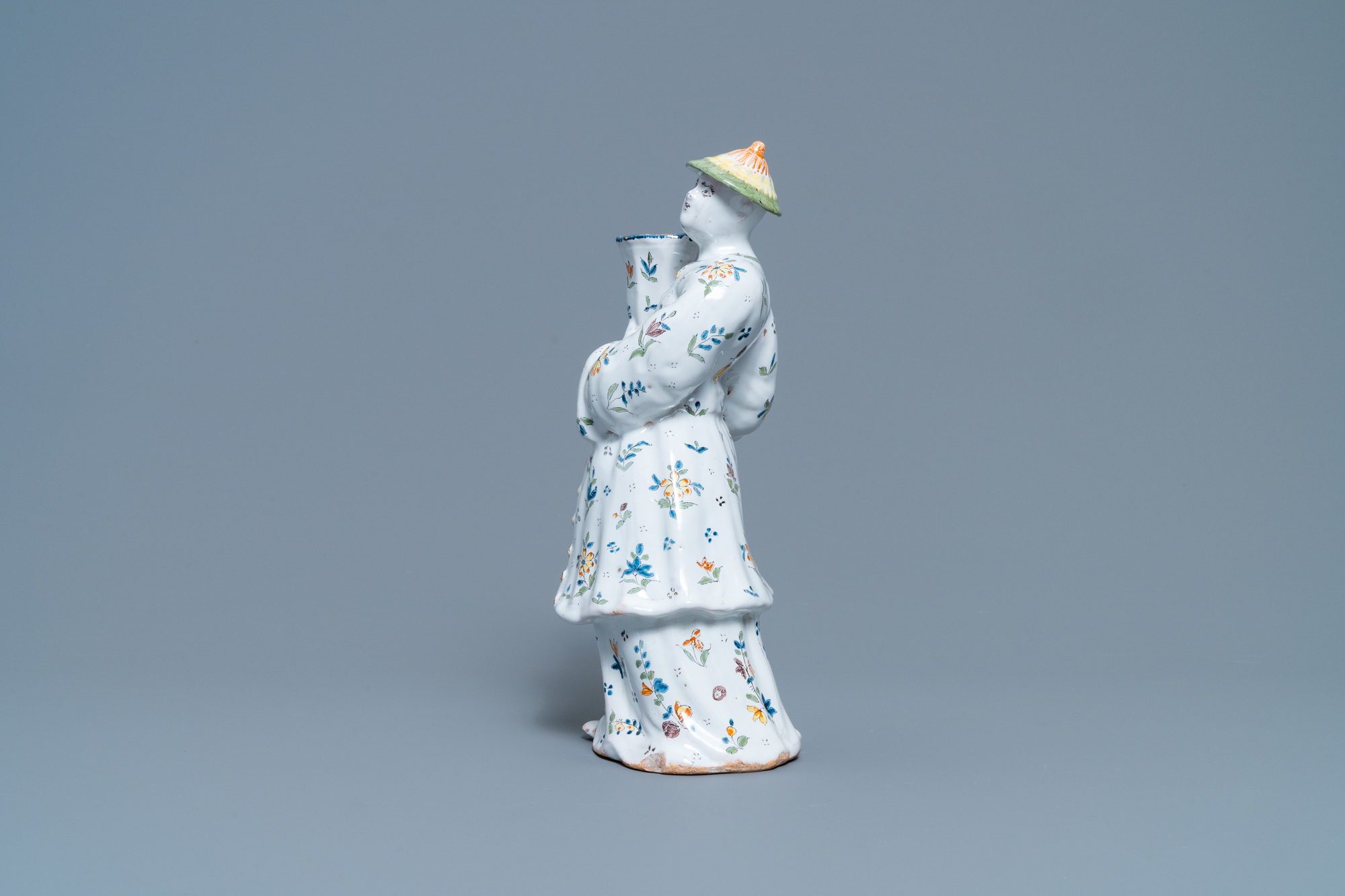 A polychrome French faience candle holder in the shape of a Chinaman, Lille, 18th C. - Image 5 of 7