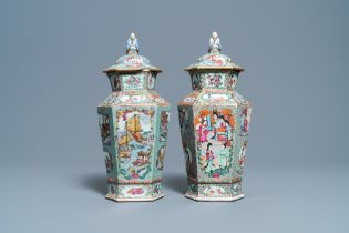 Two Chinese hexagonal Canton famille rose vases and covers, 19th C.