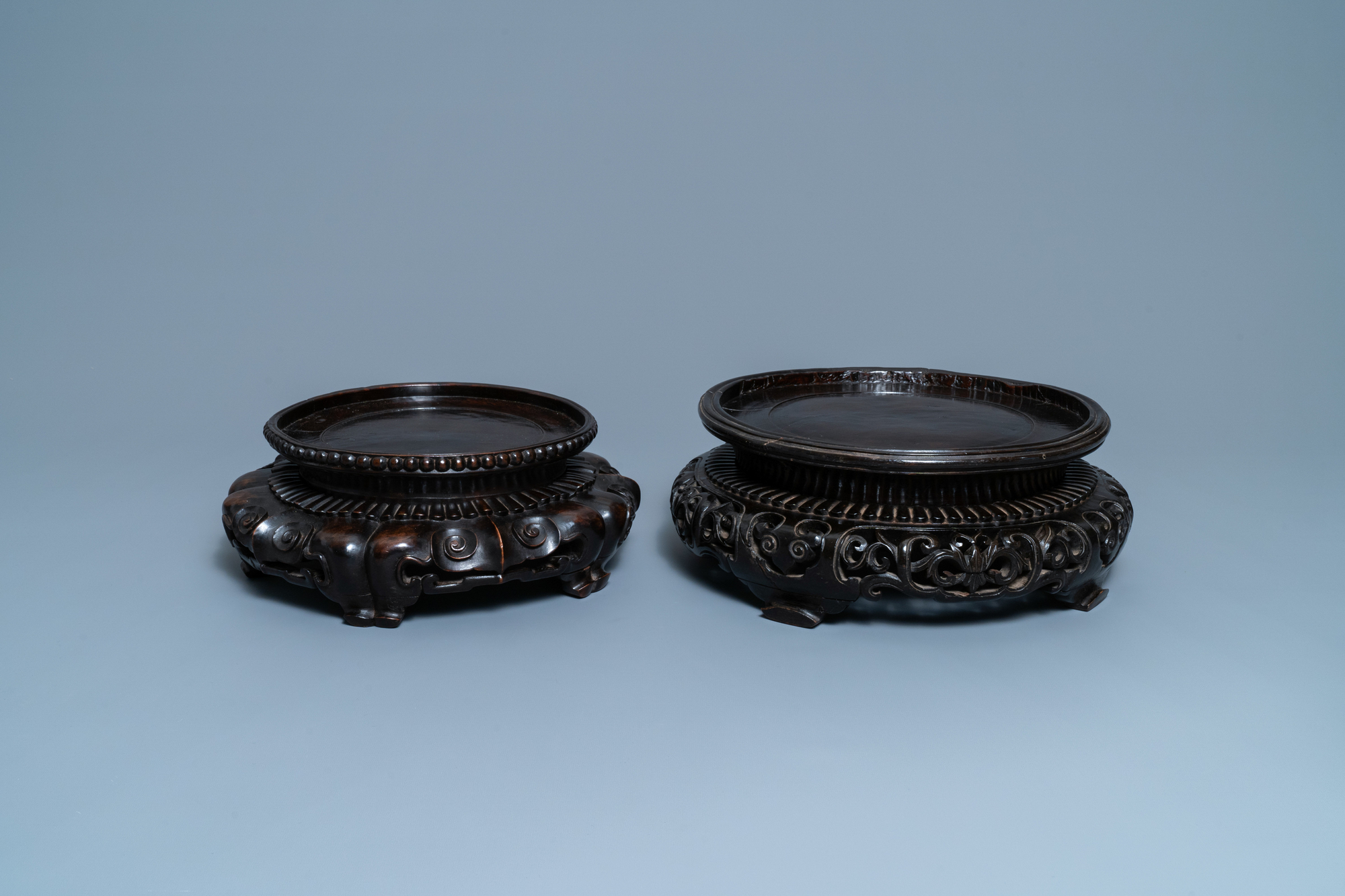 Two large Chinese reticulated wooden stands, 18/19th C.