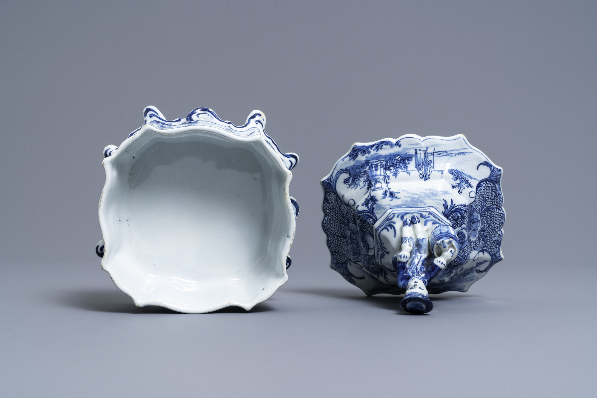 A Dutch Delft blue and white tobacco box and cover with a boy near a barrel, 18th C. - Image 5 of 7