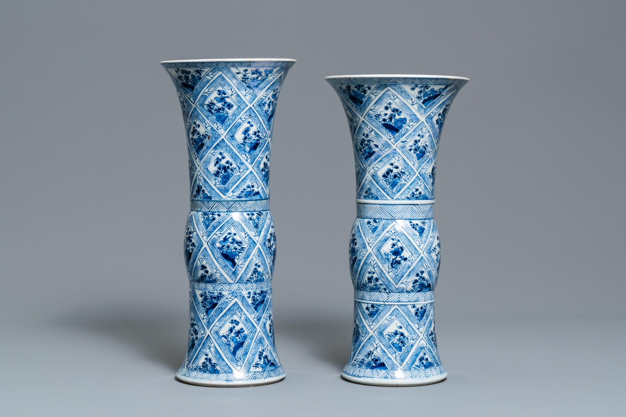 A large Chinese blue and white five-piece garniture with floral and landscape panels, Kangxi - Image 11 of 66