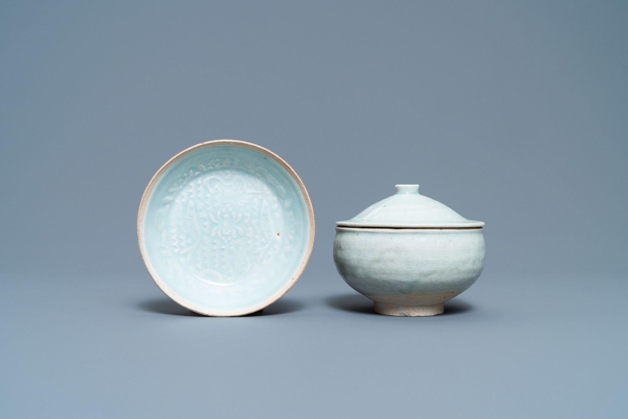 A Chinese qingbai molded 'fish' dish and a bowl with cover, Song/Yuan