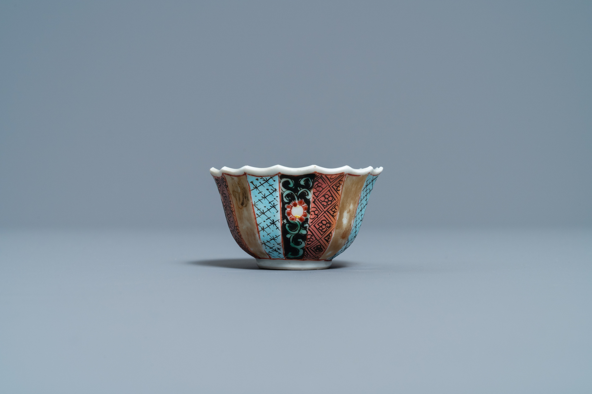 A lobed Chinese famille rose 'fishermen' cup and saucer, Yongzheng - Image 4 of 9