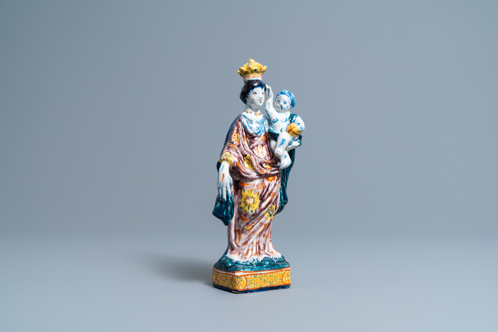A polychrome Dutch Delft figure of the Madonna with child, 18th C.