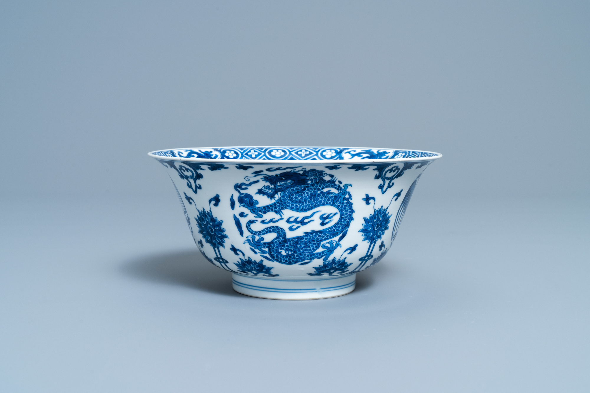 A Chinese blue and white 'dragon and phoenix bowl', Chenghua mark, Kangxi - Image 2 of 17