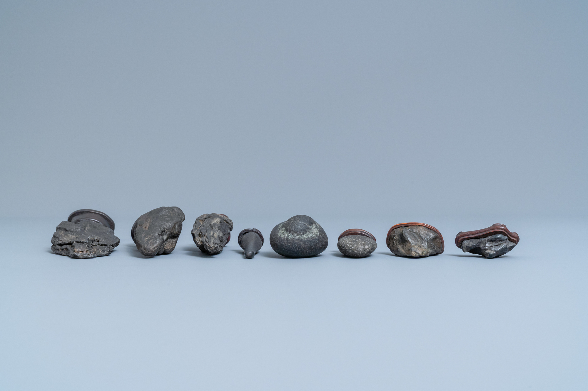 Eight Chinese scholar's rocks on wooden stands, 19/20th C. - Image 6 of 7