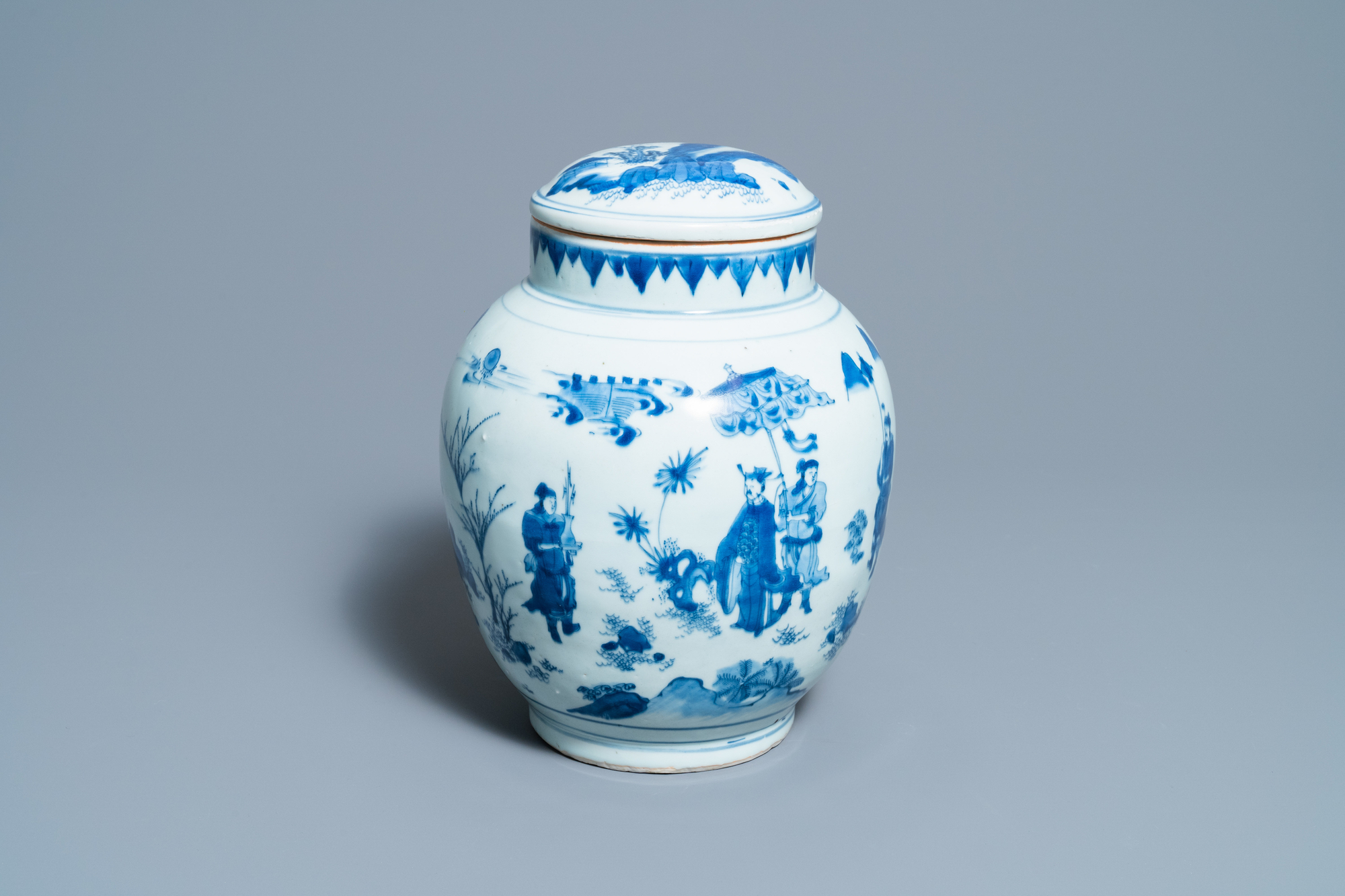 A Chinese blue and white jar and cover with figures in a landscape, Transitional period