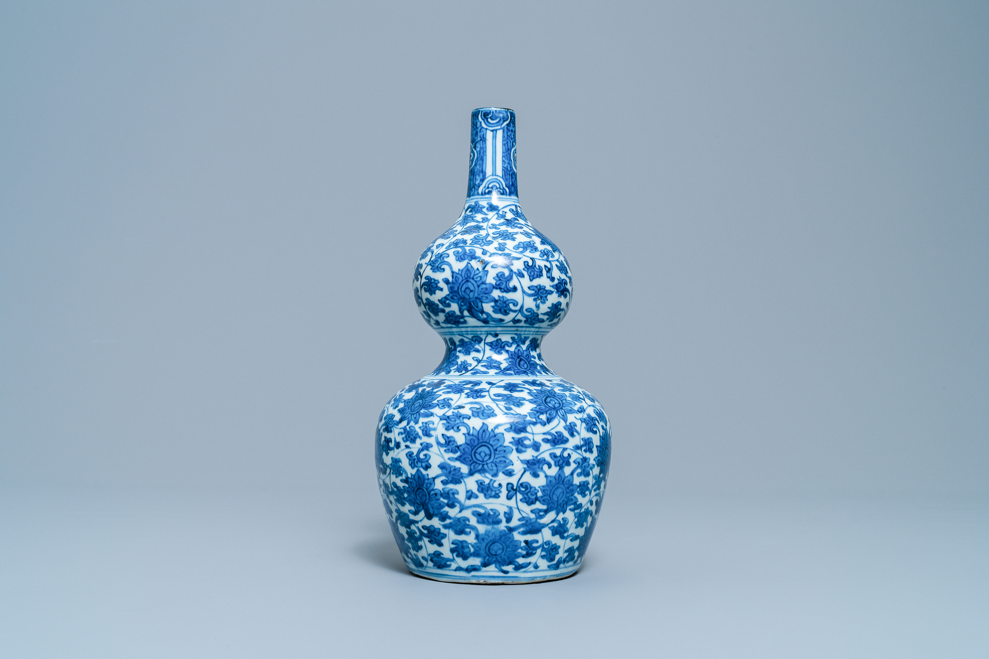 A Chinese blue and white 'lotus scroll' double gourd vase, Wanli - Image 3 of 8