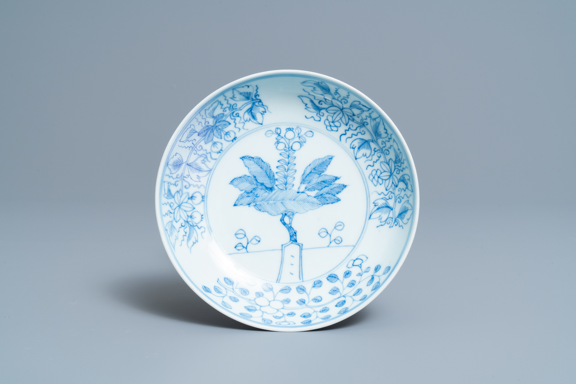 A Chinese blue and white 'pomegranate tree' plate, Yongzheng mark and of the period