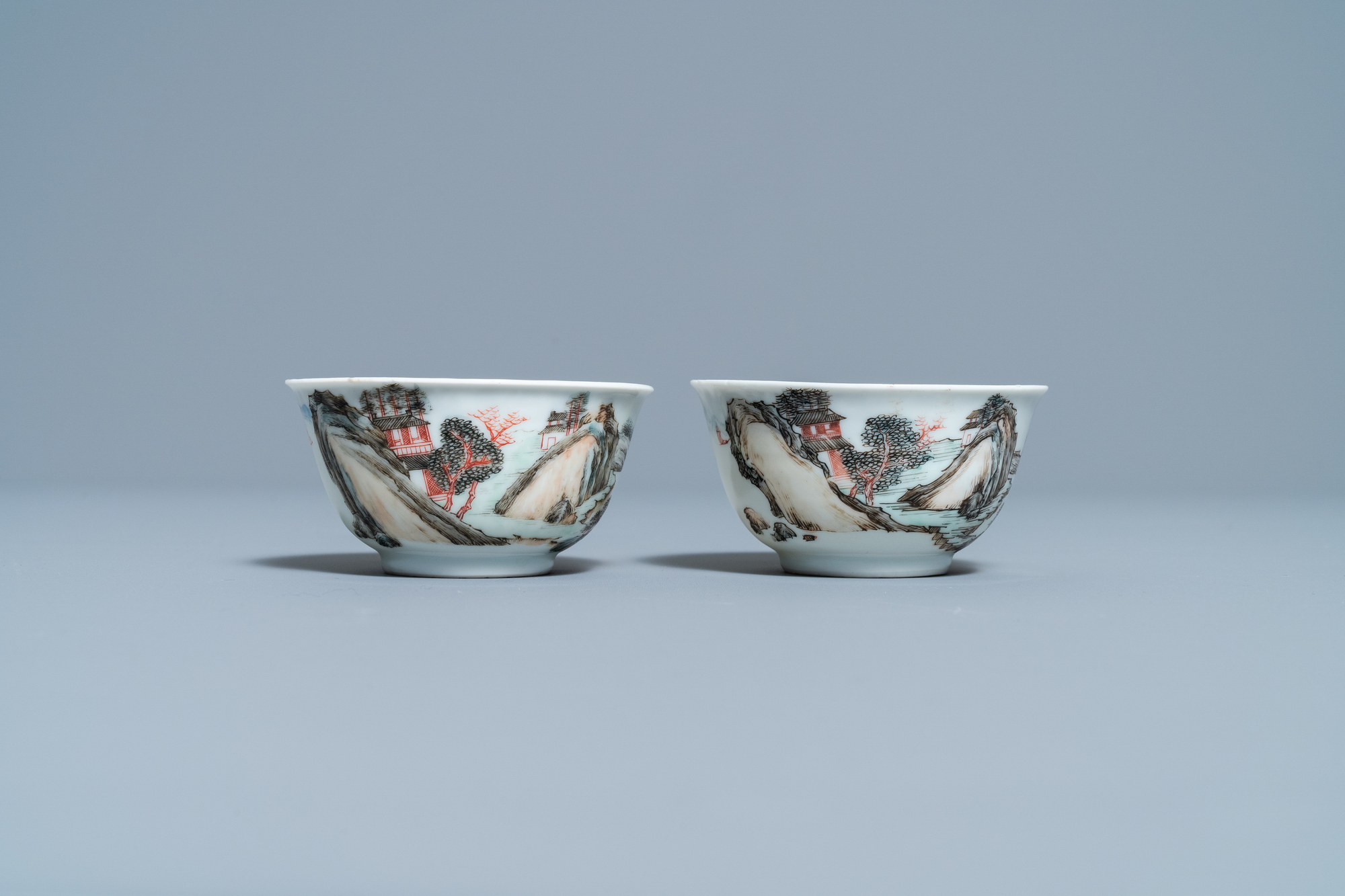 A fine Chinese 'landscape' teapot and a pair of cups and saucers, Yongzheng - Image 4 of 15
