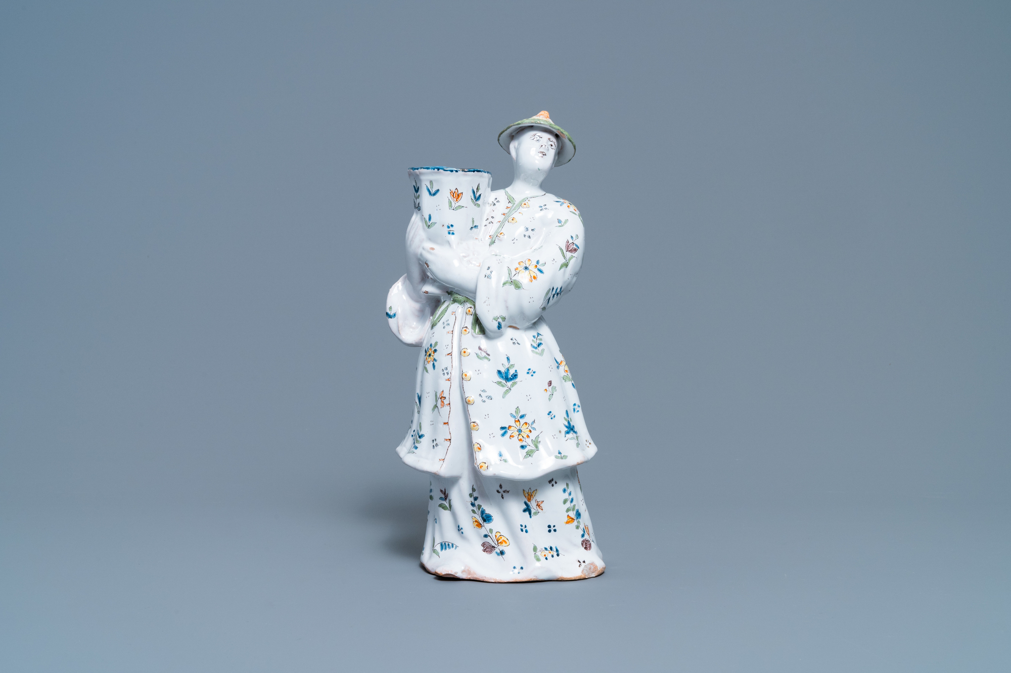 A polychrome French faience candle holder in the shape of a Chinaman, Lille, 18th C. - Image 2 of 7