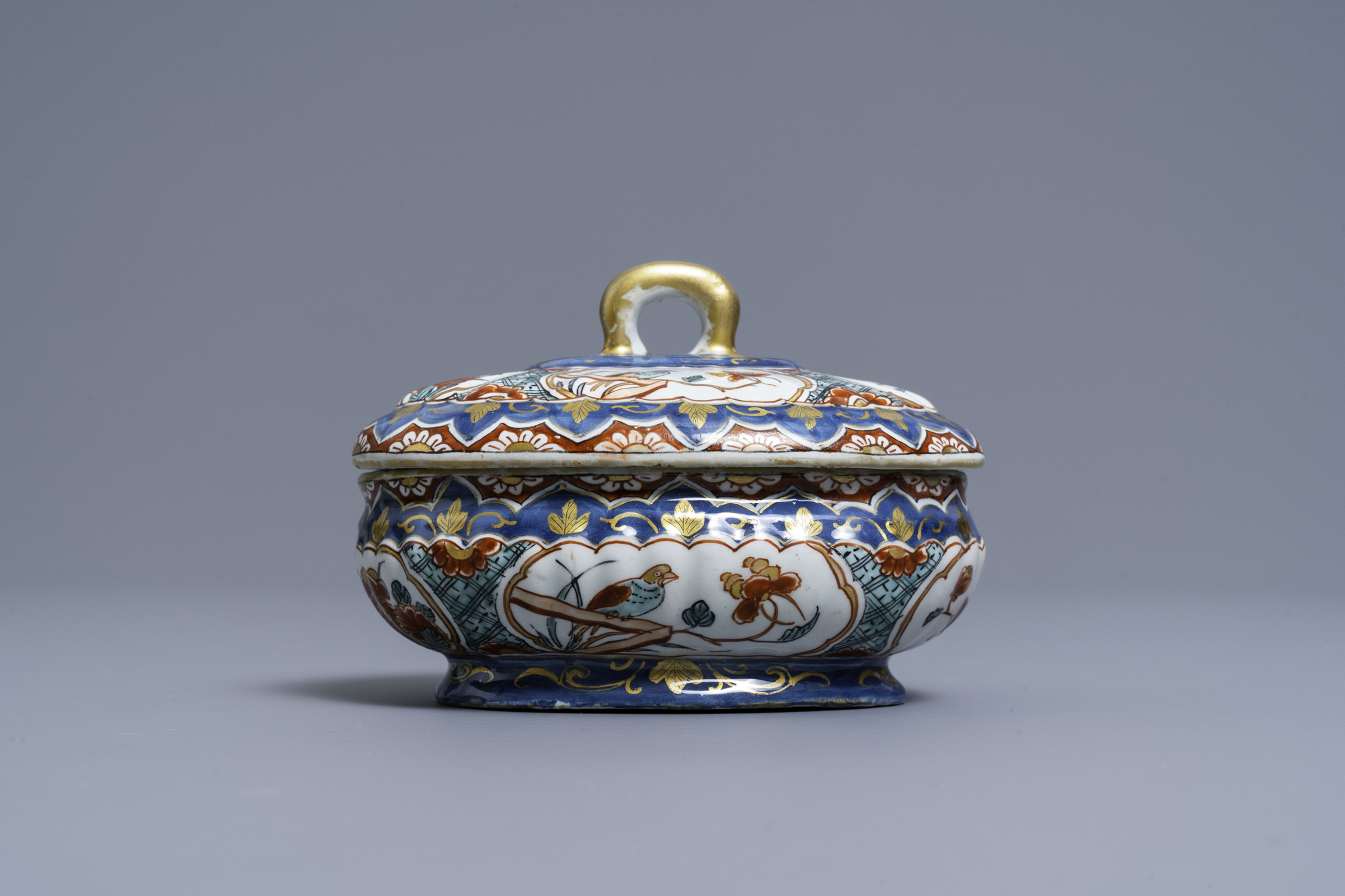 A polychrome and gilded Dutch Delft spice box and cover, early 18th C. - Image 2 of 7