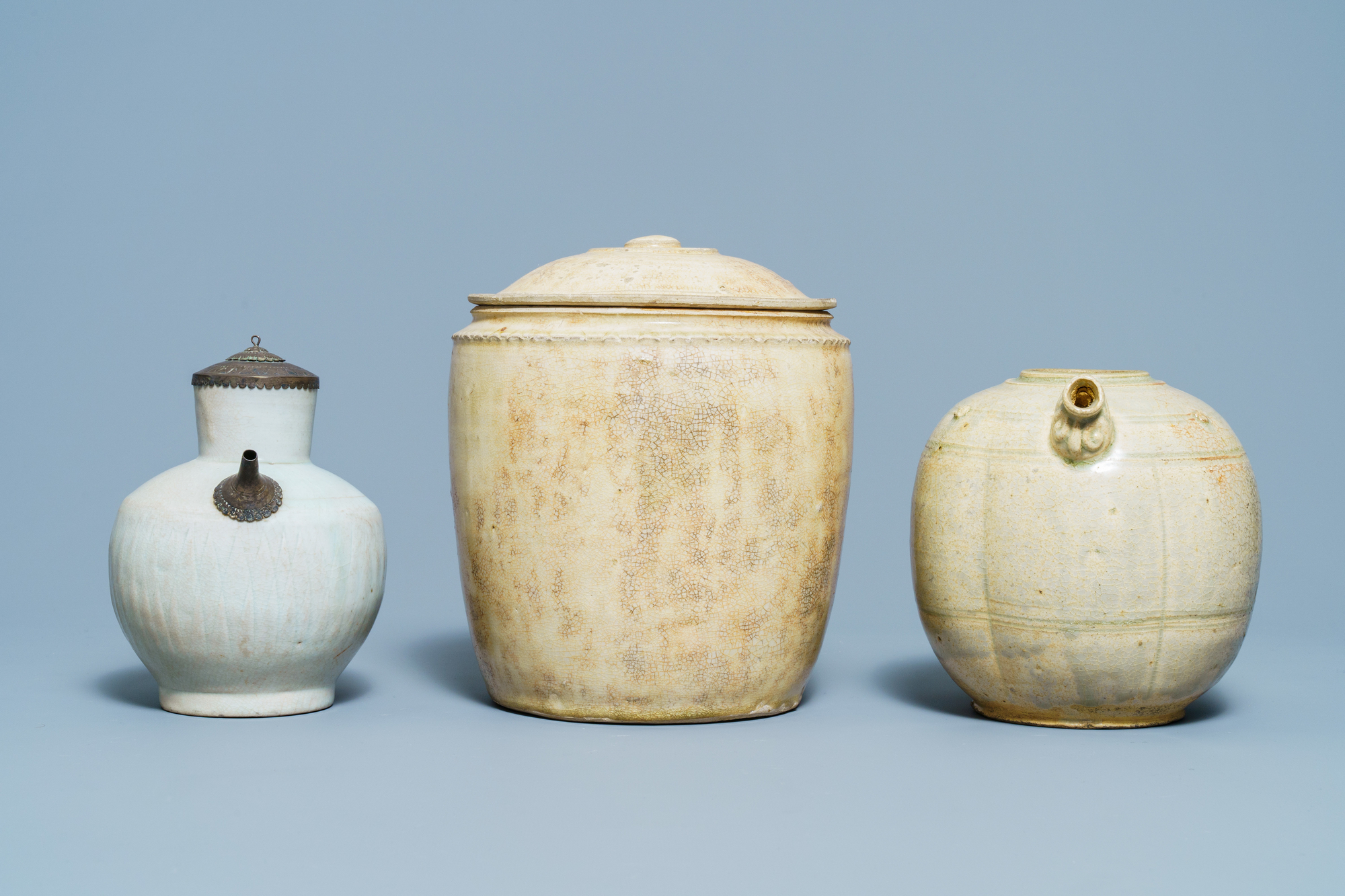 A Chinese celadon-glazed 'Jue' ewer, a qingbai-glazed wine ewer and a storage vessel, Song/Yuan - Image 5 of 9
