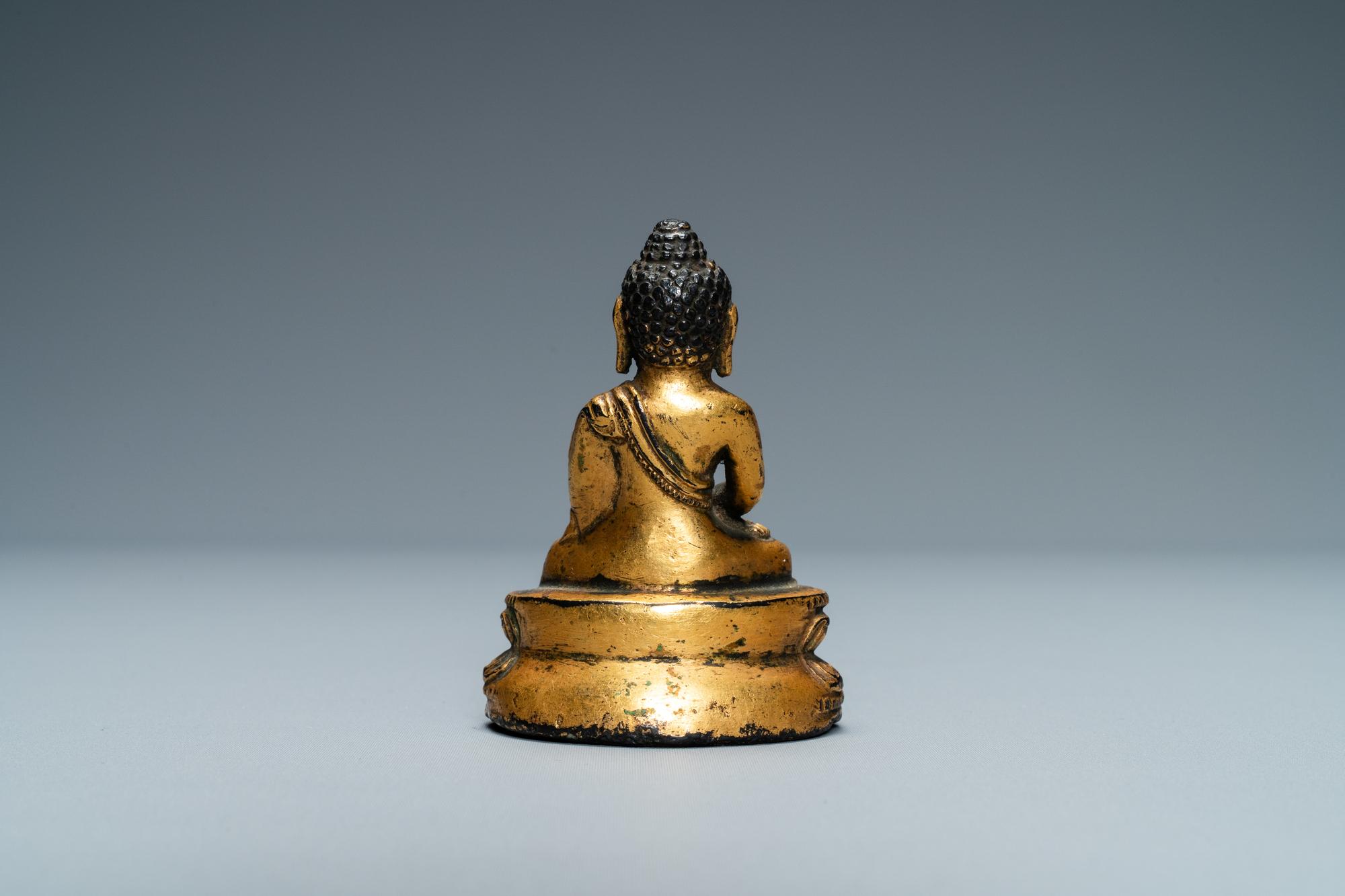 A Sino-Tibetan gilt bronze figure of Buddha, Ming - Image 3 of 7