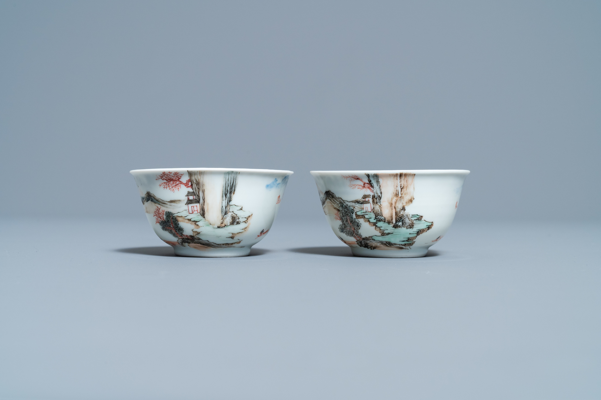 A fine Chinese 'landscape' teapot and a pair of cups and saucers, Yongzheng - Image 6 of 15