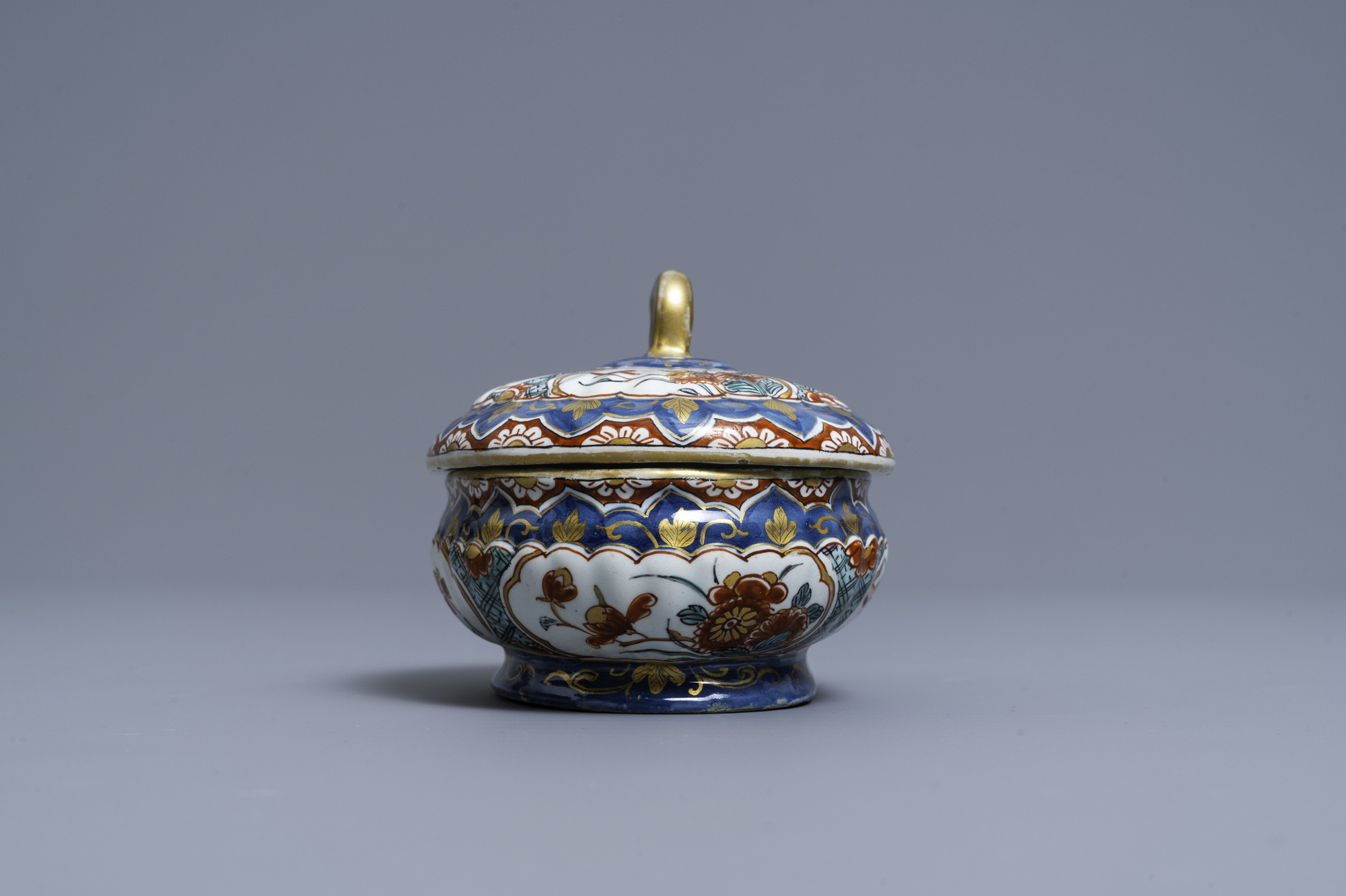 A polychrome and gilded Dutch Delft spice box and cover, early 18th C. - Image 3 of 7