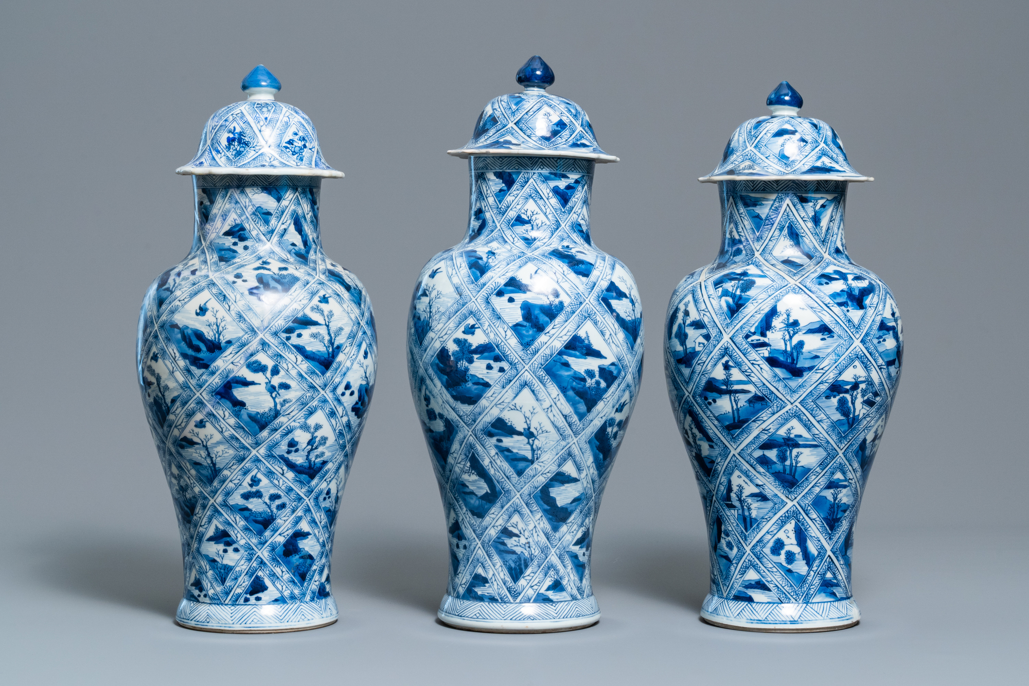 A large Chinese blue and white five-piece garniture with floral and landscape panels, Kangxi - Image 4 of 66