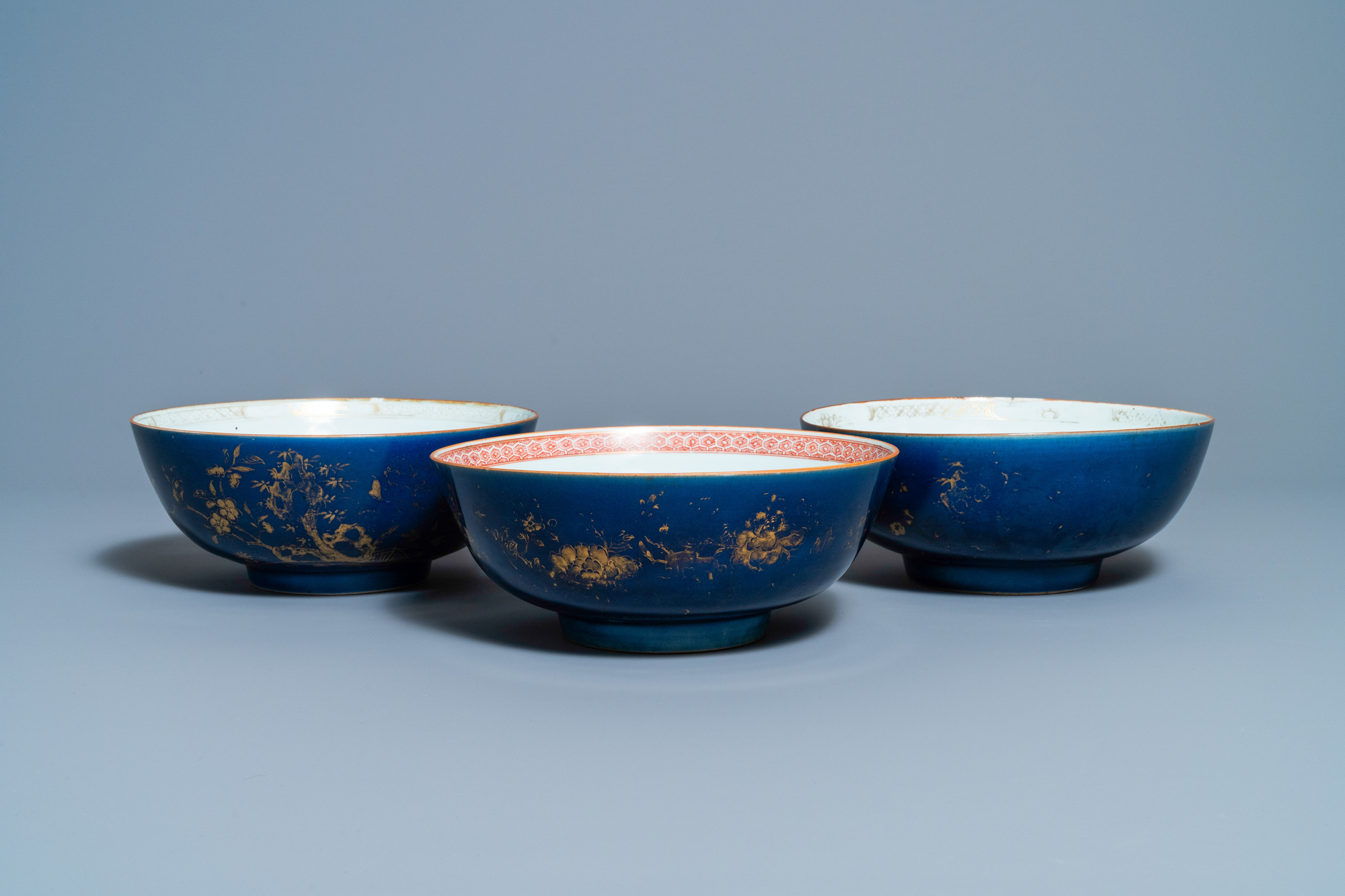 Three Chinese gilt-decorated monochrome blue bowls, Kangxi