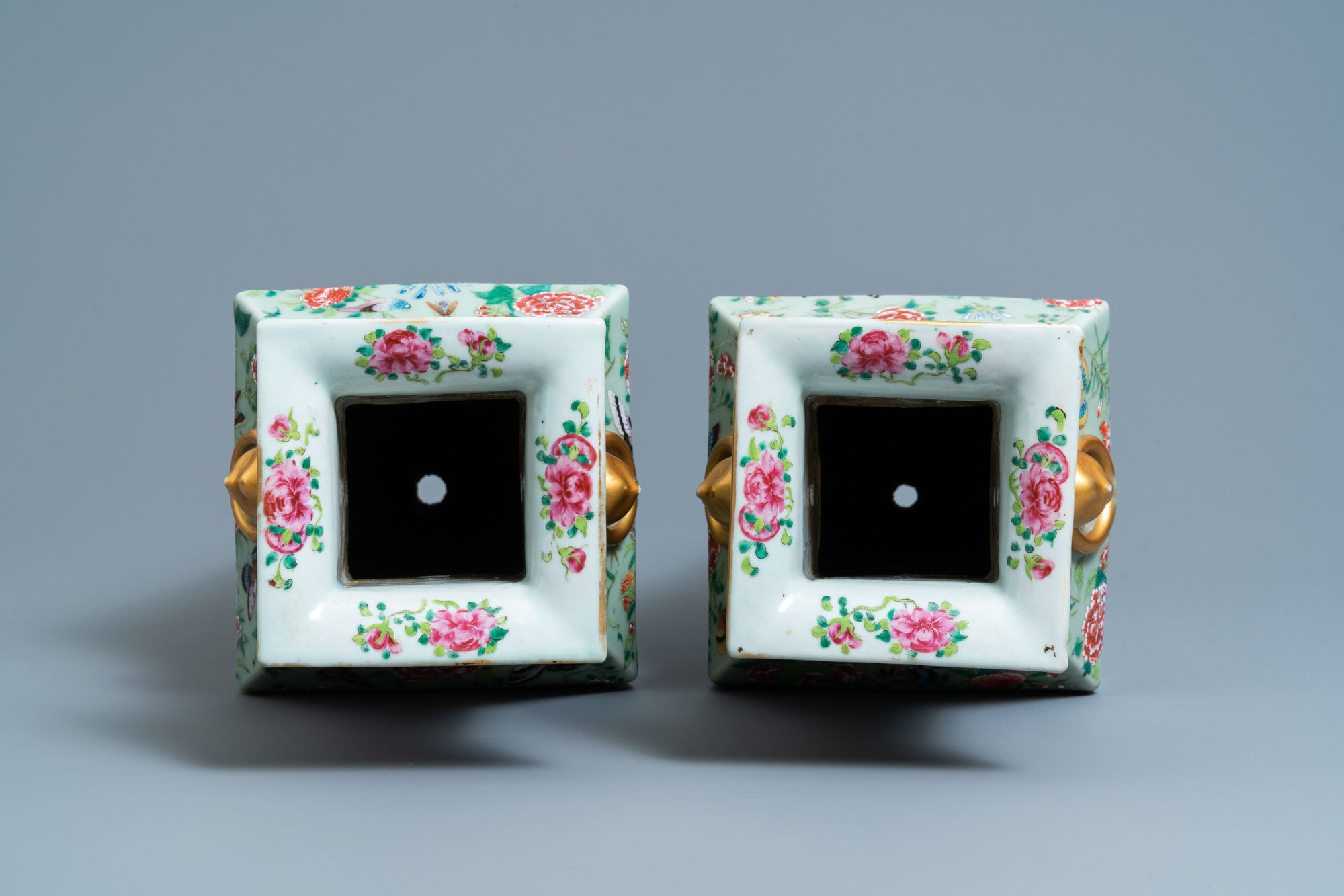 A pair of Chinese square famille rose celadon-ground vases on gilt bronze feet, 19th C. - Image 6 of 7