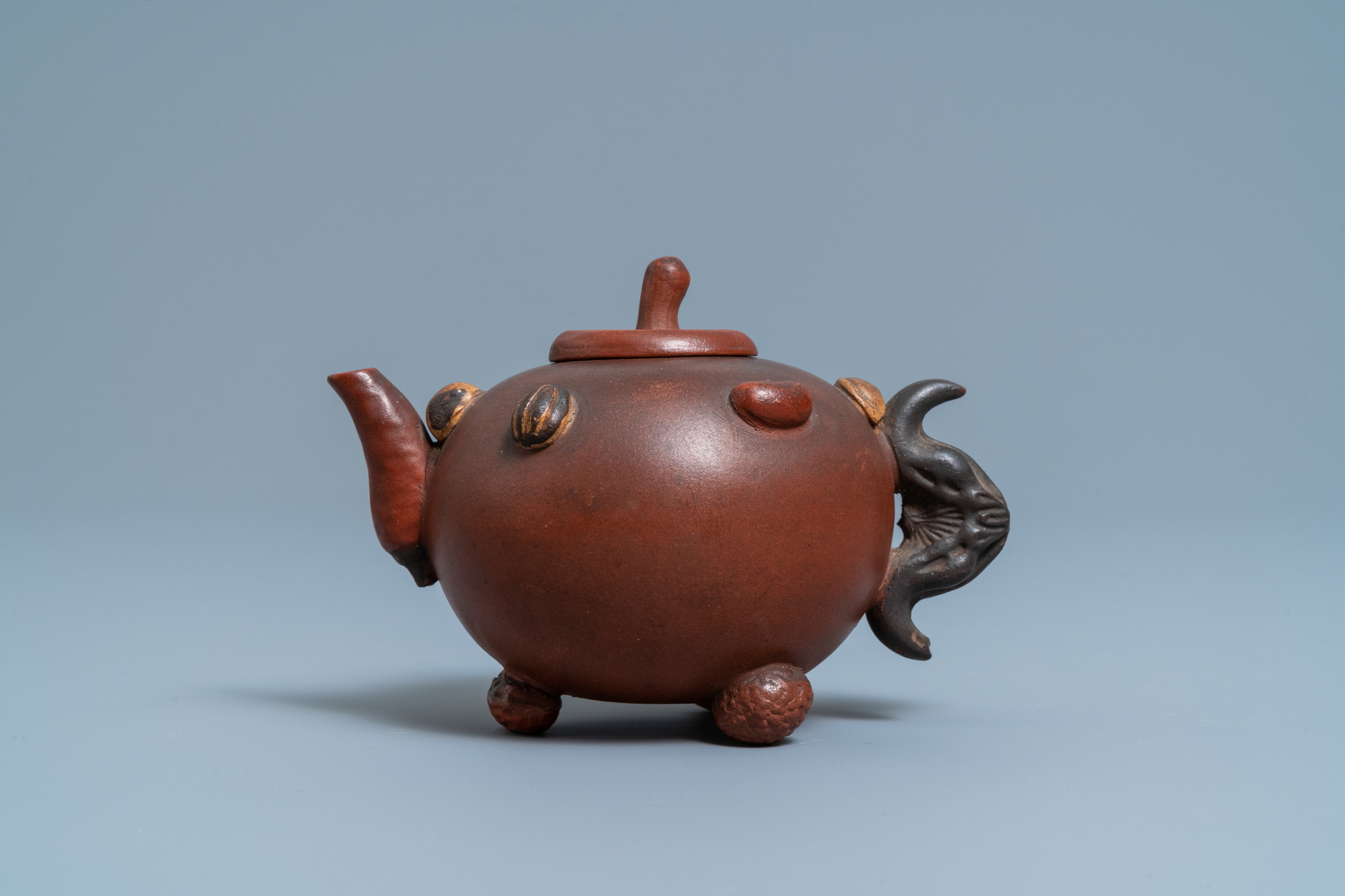 A Chinese Yixing stoneware teapot and cover with applied nuts, 19/20th C. - Image 2 of 7