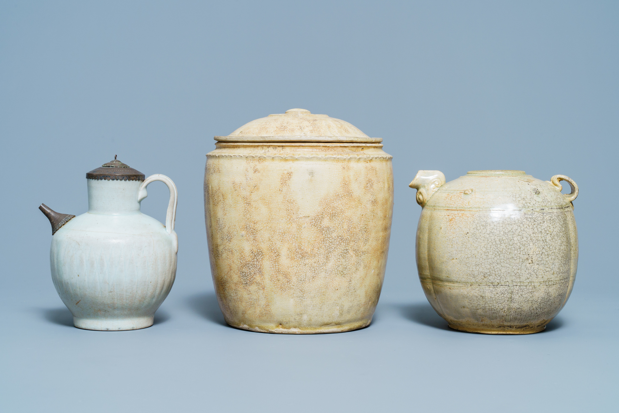 A Chinese celadon-glazed 'Jue' ewer, a qingbai-glazed wine ewer and a storage vessel, Song/Yuan - Image 2 of 9