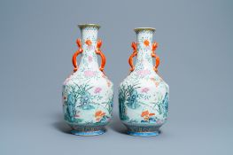 A pair of Chinese famille rose 'floral scenery' vases, Jiaqing mark, 19th C.