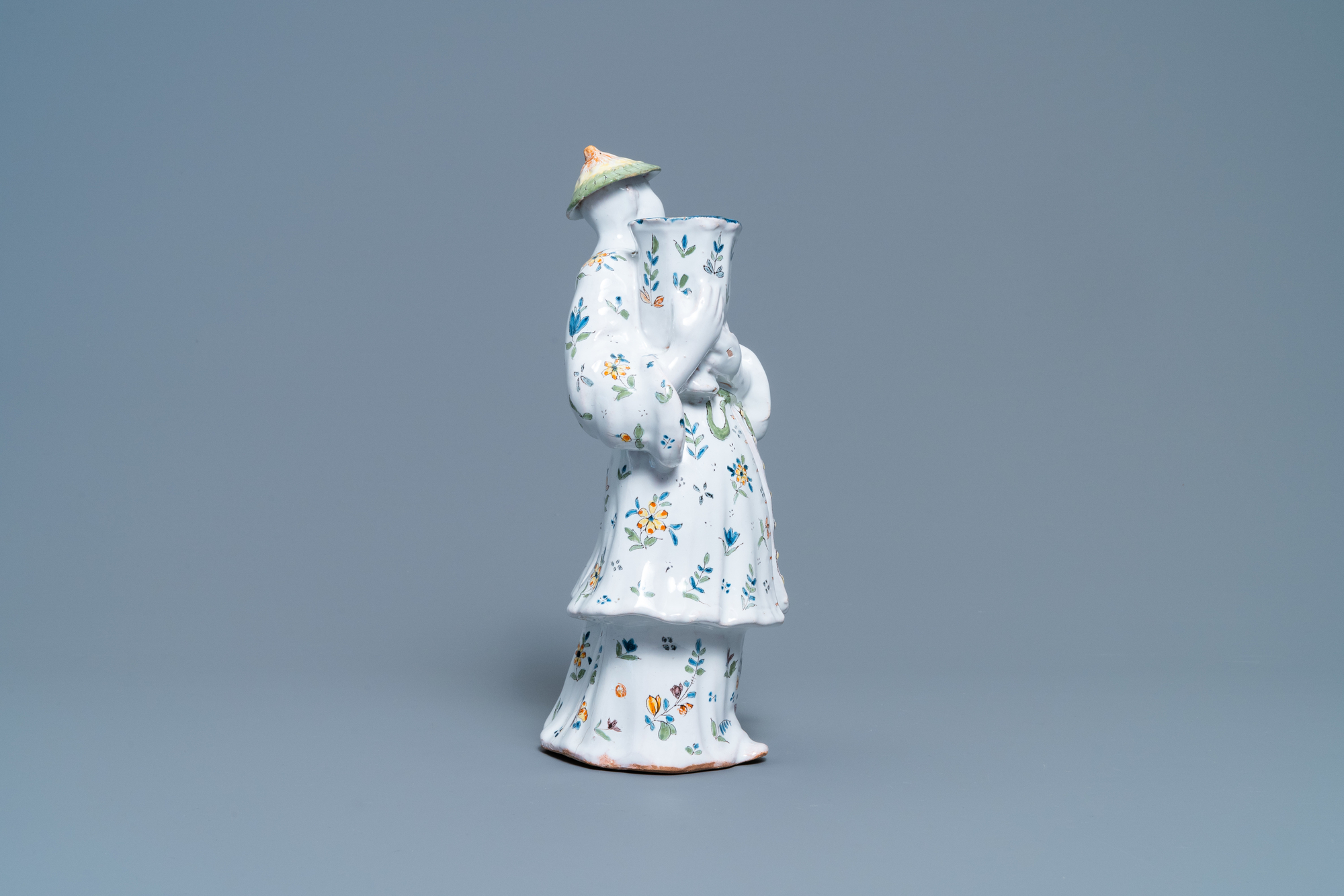 A polychrome French faience candle holder in the shape of a Chinaman, Lille, 18th C. - Image 3 of 7