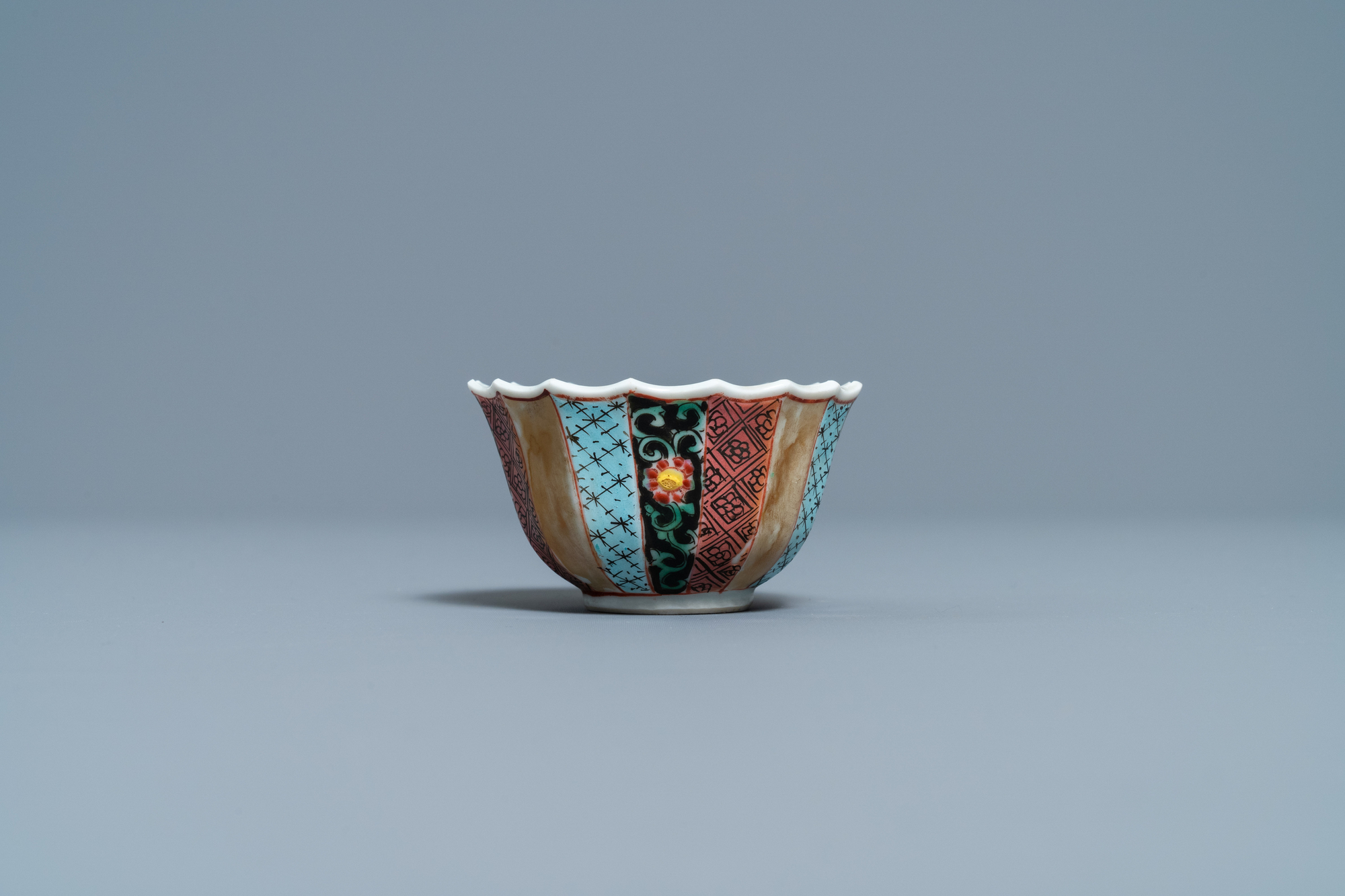 A lobed Chinese famille rose 'fishermen' cup and saucer, Yongzheng - Image 6 of 9