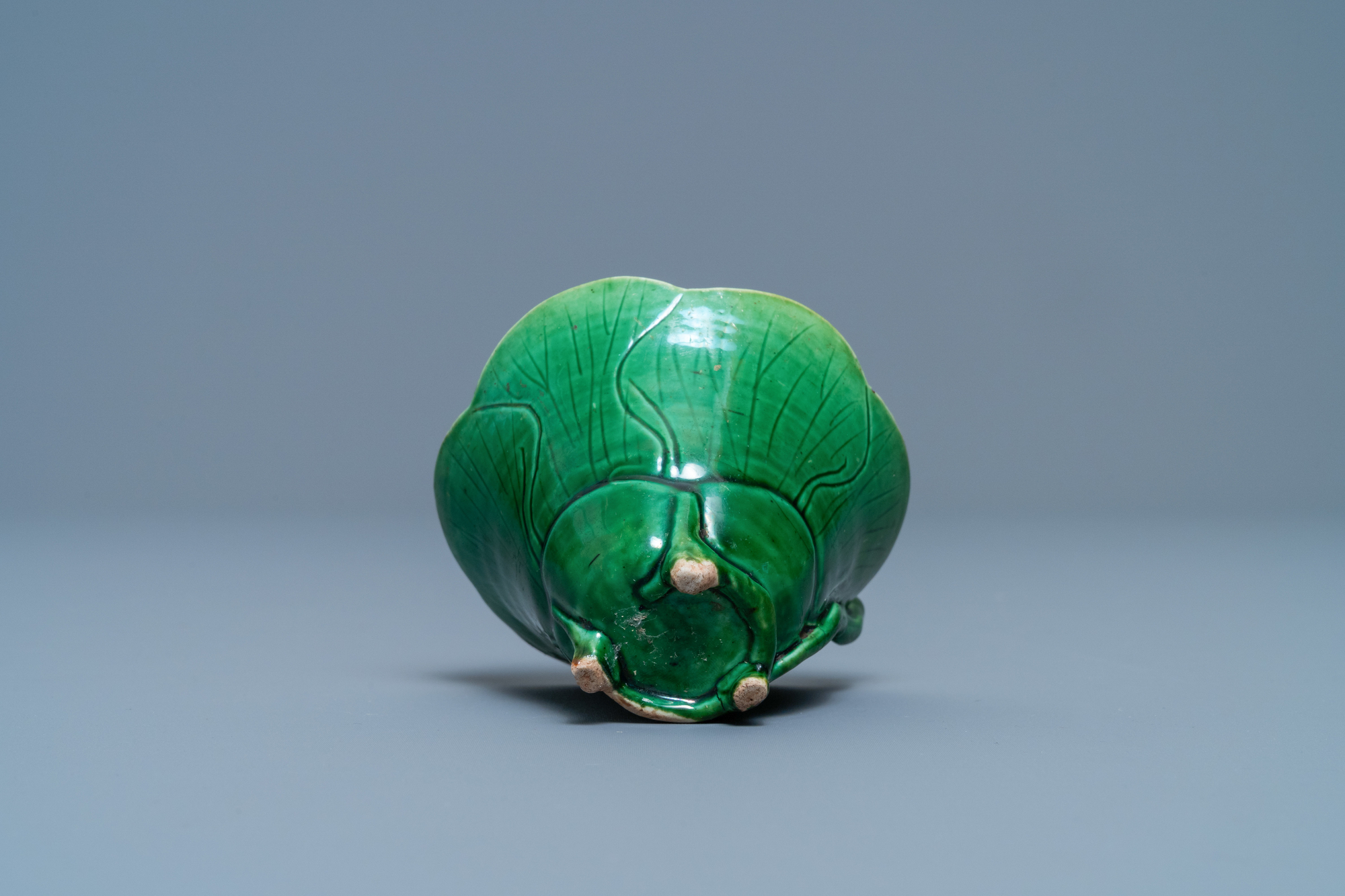 A Chinese 'egg and spinach'-glazed lotus cup and saucer with applied design, Kangxi - Image 9 of 9