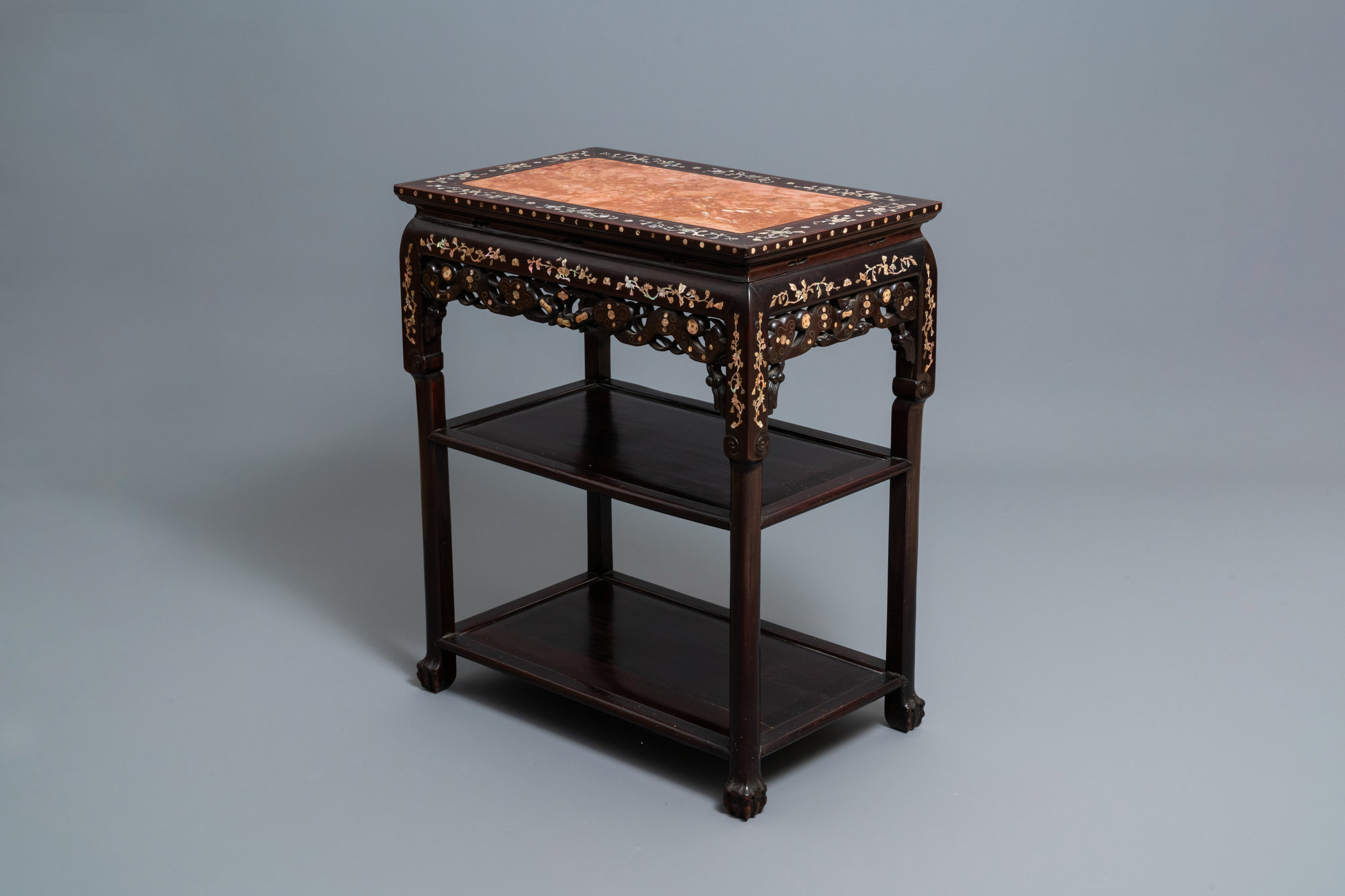 A Chinese mother-of-pearl-inlaid wooden sideboard with marble top, 19th C.