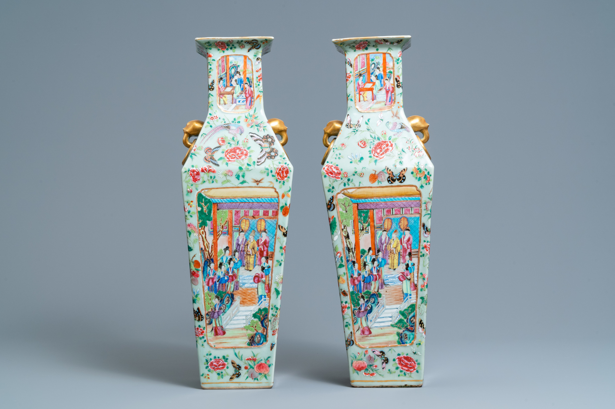 A pair of Chinese square famille rose celadon-ground vases on gilt bronze feet, 19th C. - Image 4 of 7