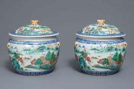 A pair of Chinese famille rose bowls and covers with landscapes, Qianlong mark, Republic